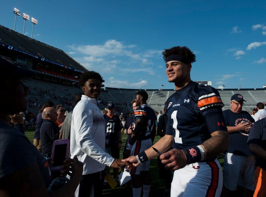 Auburn quarterback Joey Gatewood (1) signs autographs after the A-Day spring game in Auburn, Ala., on Saturday, April 13, 2019.