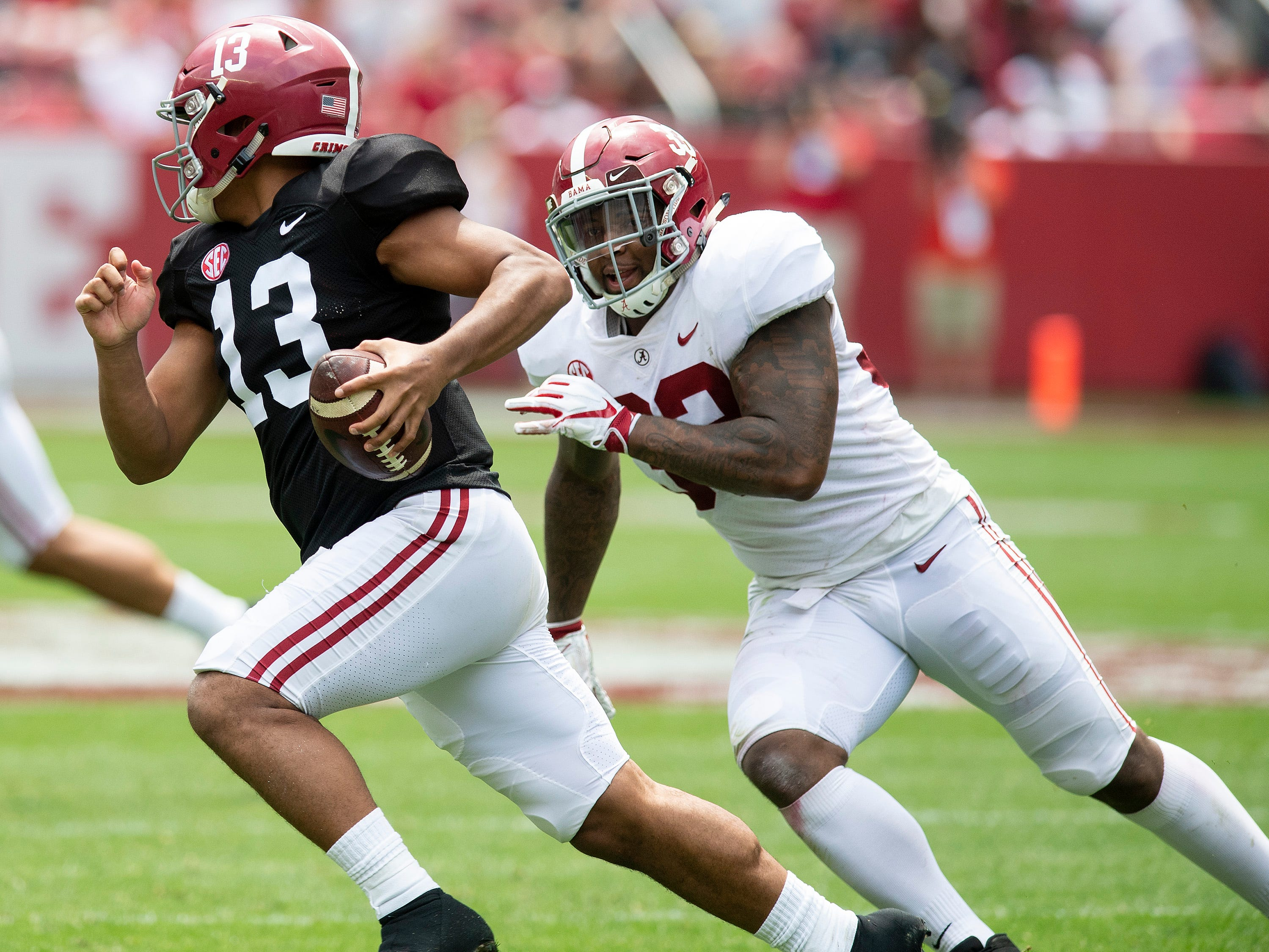Linebacker Anfernee Jennings (33) chases quarterback Tua Tagovailoa (13) during first half action in the Alabama A-Day spring football scrimmage game at Bryant Denny Stadium in Tuscaloosa, Ala., on Saturday April 13, 2019.