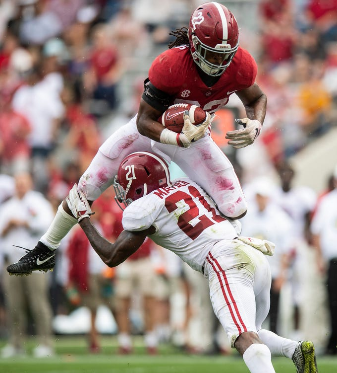 Aunning back Najee Harris (22) tries to hurdle defensive back Jared Mayden (21) during second half action in the Alabama A-Day spring football scrimmage game at Bryant Denny Stadium in Tuscaloosa, Ala., on Saturday April 13, 2019.