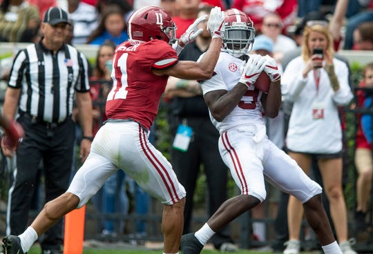 Wide receiver Xavier Williams (9) catches a touchdown pass against defensive back Scooby Carter (11) during first half action in the Alabama A-Day spring football scrimmage game at Bryant Denny Stadium in Tuscaloosa, Ala., on Saturday April 13, 2019.