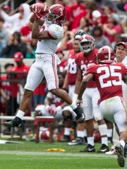 Alabama wide receiver John Metchie (3) catches a pass during first half action in the Alabama A-Day spring football scrimmage game at Bryant Denny Stadium in Tuscaloosa, Ala., on Saturday April 13, 2019.