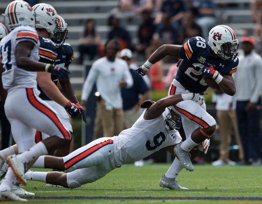 Auburn running back JaTarvious Whitlow (28) runs the ball during the A-Day spring game at Jordan-Hare Stadium in Auburn, Ala., on Saturday, April 13, 2019.