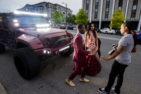 Darious Jill, right, takes prom photos of Antarrio Howard and Anjaleek Velez in Montgomery, Ala., on Friday April 12, 2019.