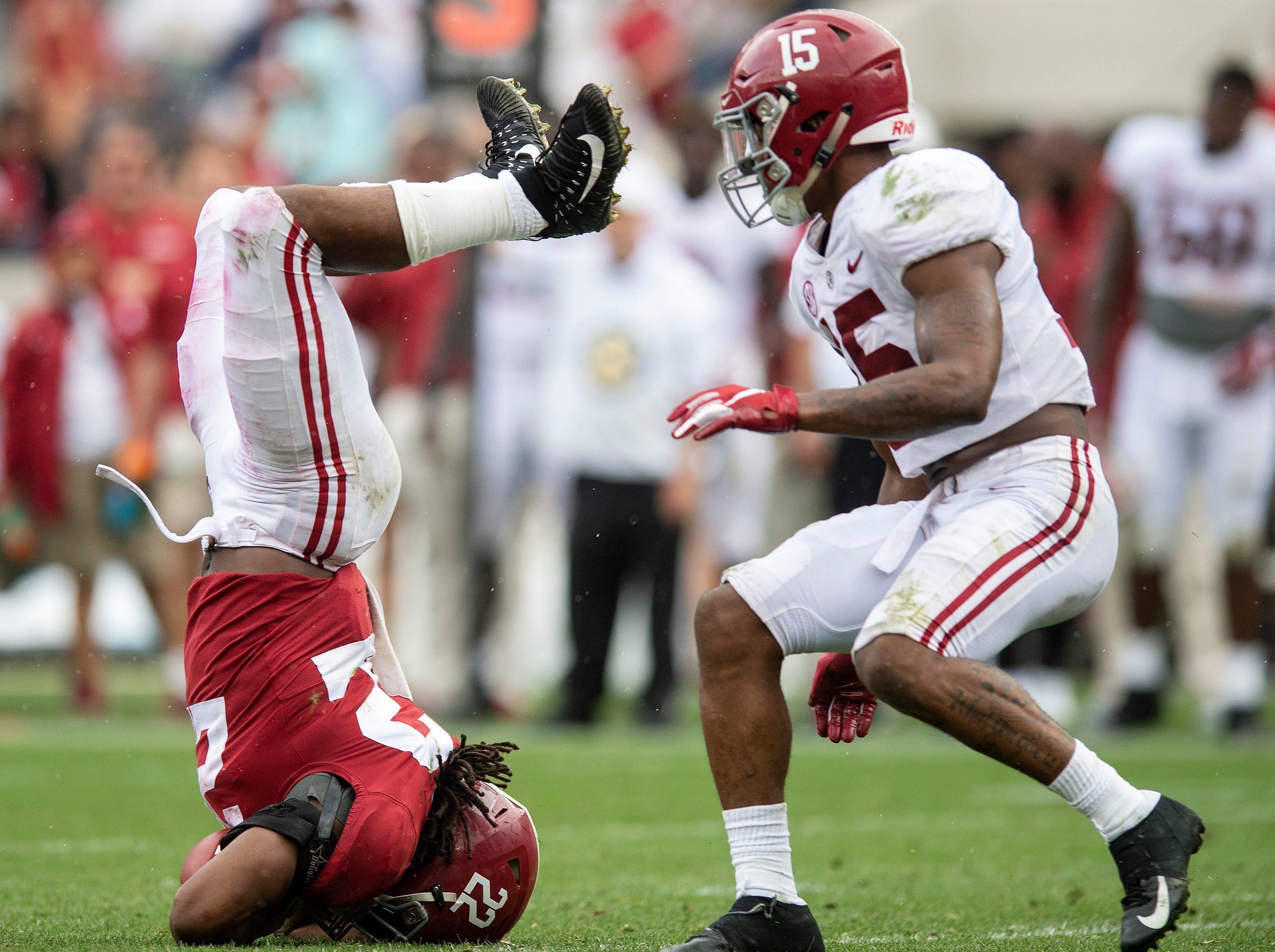 Alabama running back Najee Harris (22) face plants after being upended during second half action in the Alabama A-Day spring football scrimmage game at Bryant Denny Stadium in Tuscaloosa, Ala., on Saturday April 13, 2019.