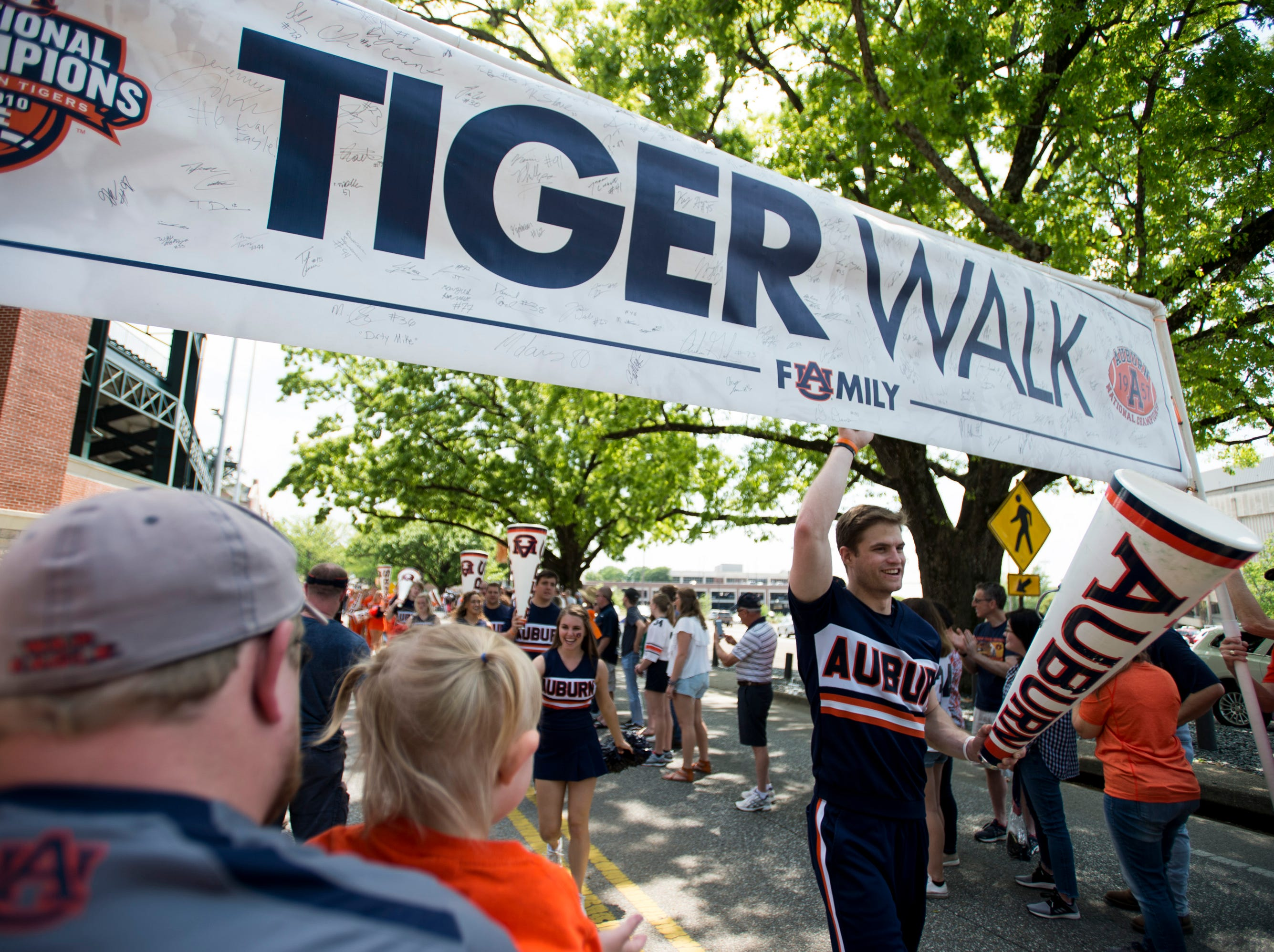 Cheerleaders lead the Tiger Walk during the A-Day spring practice gameat Jordan-Hare Stadium in Auburn, Ala., on Saturday, April 13, 2019.