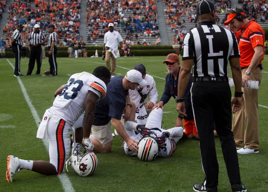 Auburn linebacker Chandler Wooten (31) goes down with an injury during the A-Day spring practice gameat Jordan-Hare Stadium in Auburn, Ala., on Saturday, April 13, 2019.