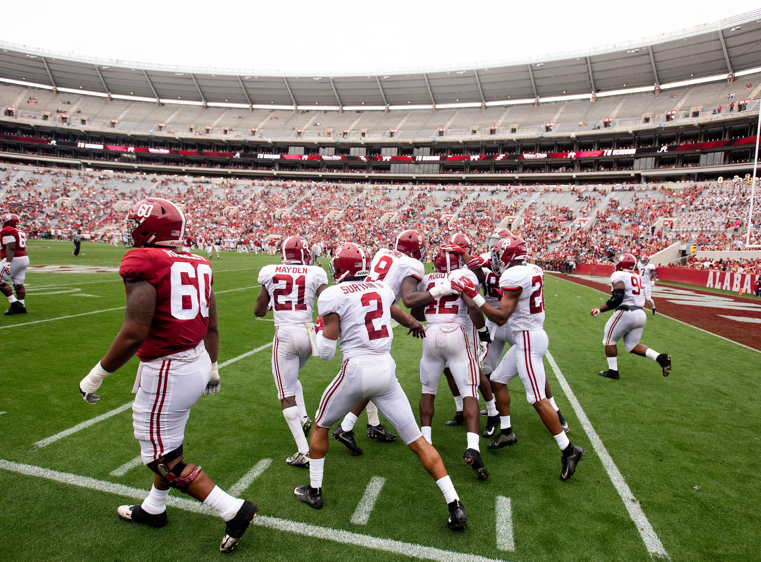 Linebacker Jaylen Moody (42) is congratulated after scoring a touchdown on an interception during second half action in the Alabama A-Day spring football scrimmage game at Bryant Denny Stadium in Tuscaloosa, Ala., on Saturday April 13, 2019.