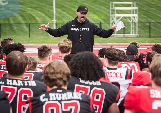 Ball State's Mike Neu talks to the team after the annual Spring Game at Scheumann Stadium Saturday, April 13, 2019.