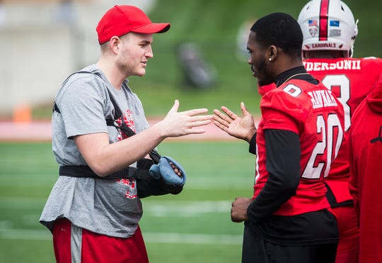 Ball State's Trey Uetrecht is greeted by teammates during their Spring Game at Scheumann Stadium Saturday, April 13, 2019. Uetrecht returned for the Spring Game after recovering from multiple surgeries following a serious car accident.