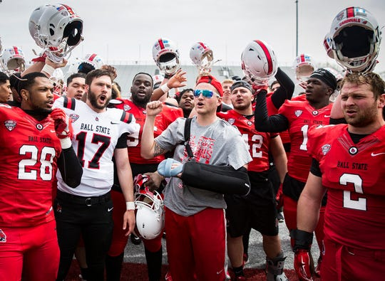 Ball State's Trey Uetrecht leads his team in their fight song during their Spring Game at Scheumann Stadium Saturday, April 13, 2019. Uetrecht returned for the Spring Game after recovering from multiple surgeries following a serious car accident.