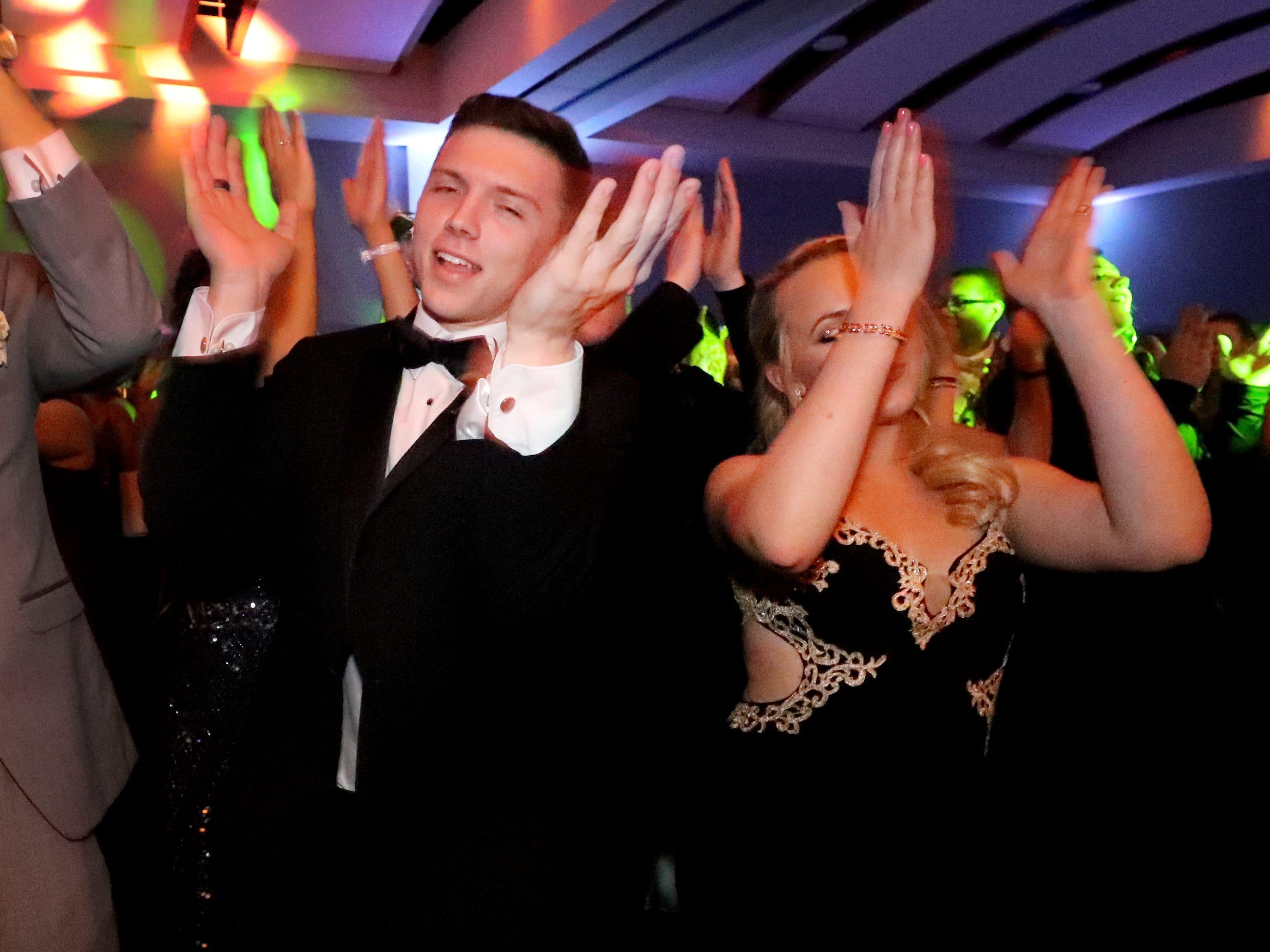 Jacob Spence left and Svetlana Baranova, right  dance at Blackman's prom on Friday April 12, 2019, at MTSU.