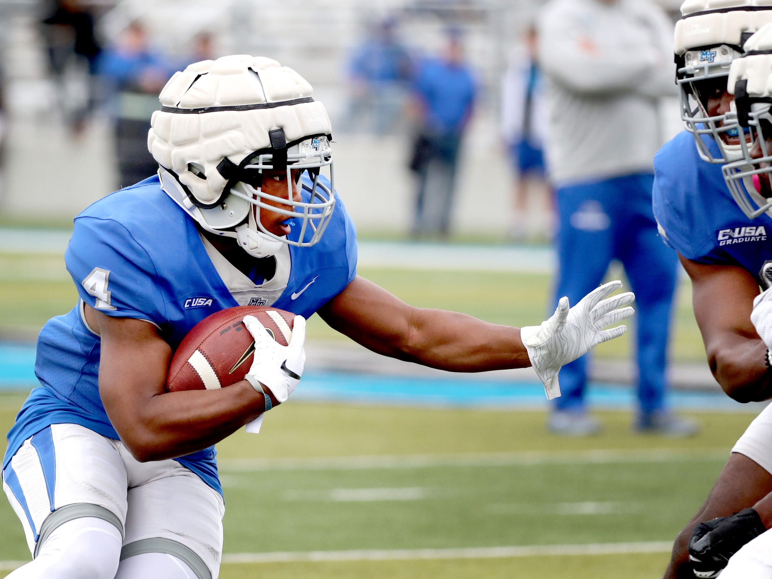 "MTSU's running back D'Monte Kemp (4) runs the ball during MTSU's Blue-White Spring Finale held on Saturday April 13, 2019, at MTSU's Johnny ""Red"" Floyd Stadium."