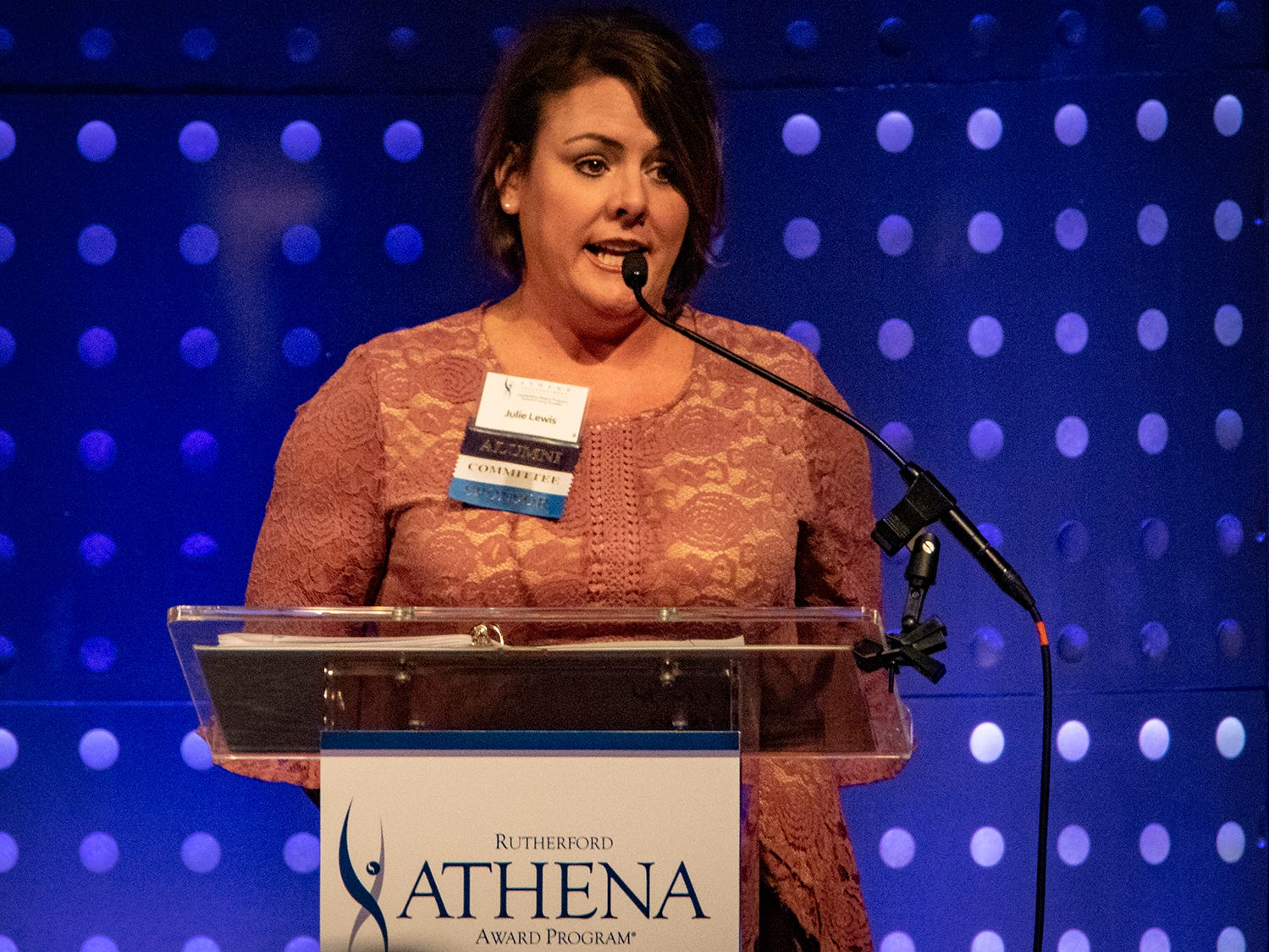 Julie Lewis recognizes sponsors of the annual ATHENA Leadership Awards, hosted by Rutherford Cable Friday, April 12, 2019 at Embassy Suites Murfreesboro.