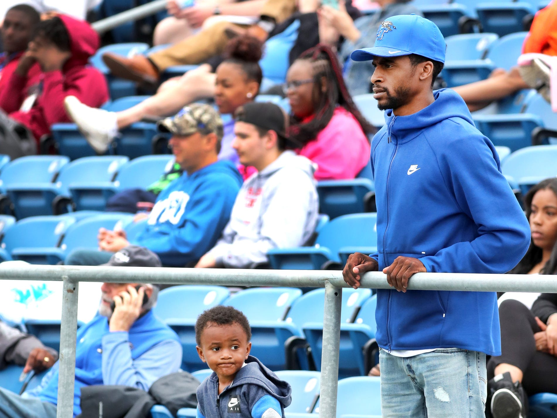 "DJ Goines, and his son Nino Goines, 3, watch MTSU's Blue-White Spring Finale held on Saturday April 13, 2019, at MTSU's Johnny ""Red"" Floyd Stadium."