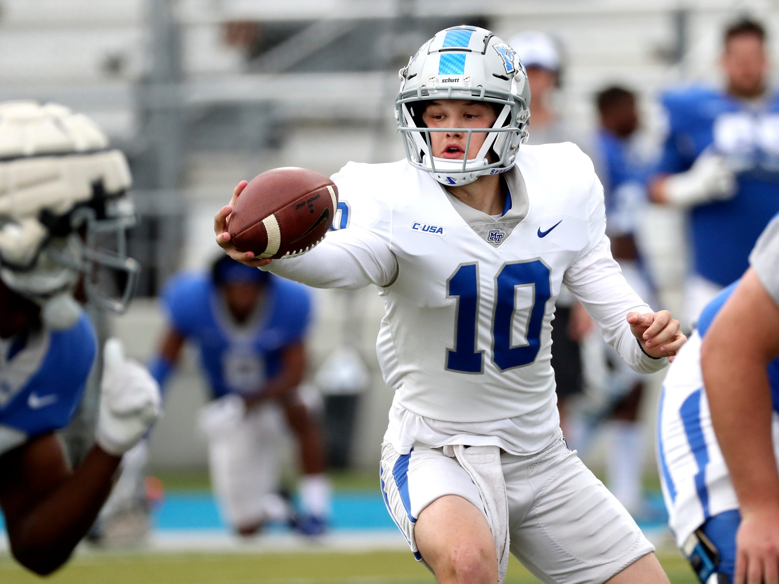 "MTSU's quarterback Asher O'Hara (10) fakes a handoff during MTSU's Blue-White Spring Finale held on Saturday April 13, 2019, at MTSU's Johnny ""Red"" Floyd Stadium."