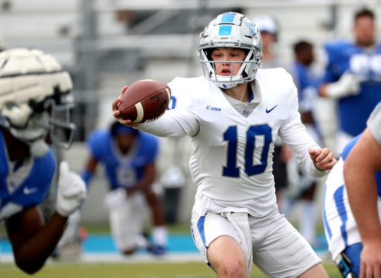 "MTSU quarterback Asher O'Hara fakes a handoff during MTSU's Blue-White Spring Finale on Saturday at Johnny ""Red"" Floyd Stadium."