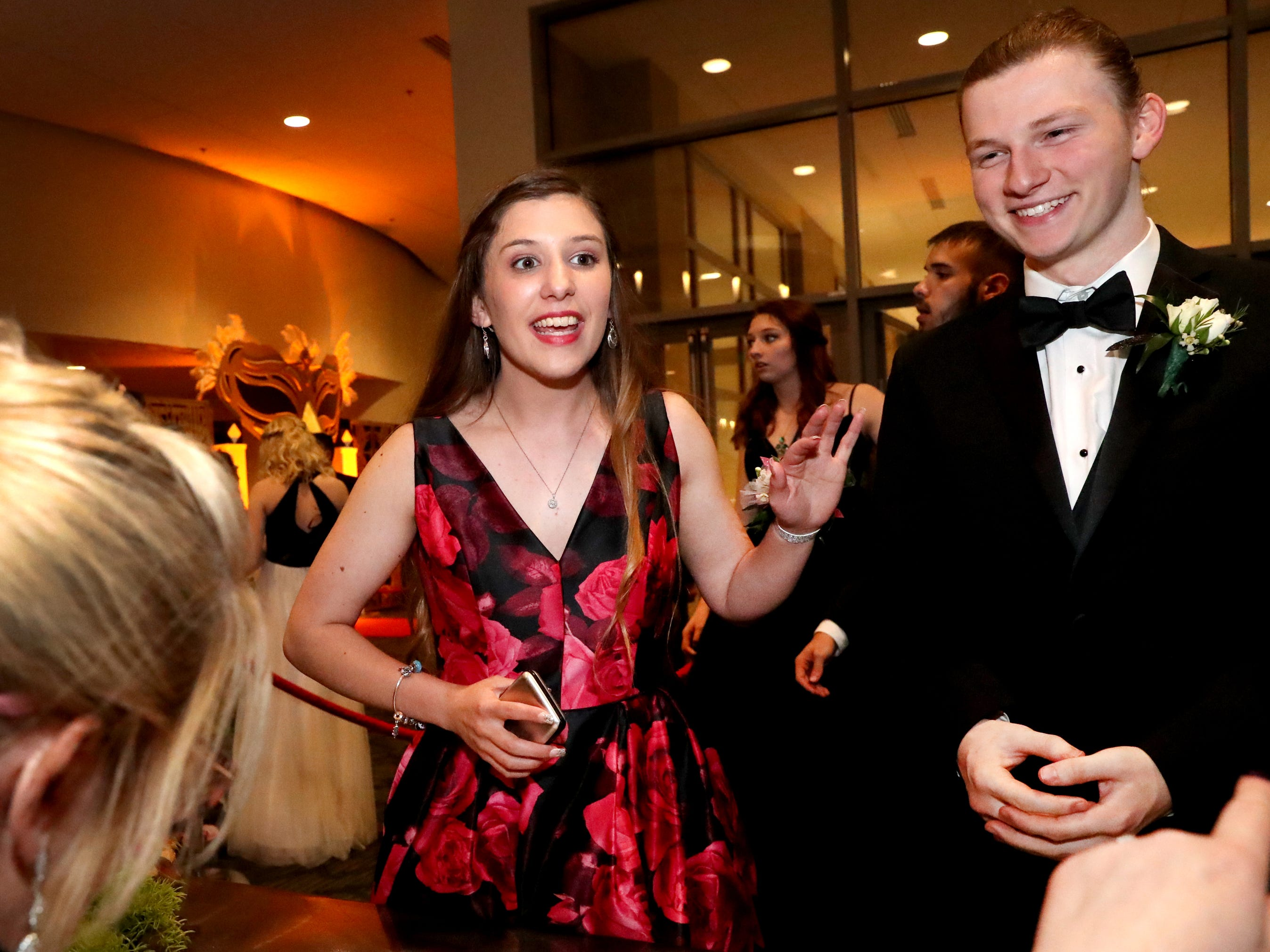 Rachel Blair, left and Micah Curtis, right  check in as they enter Blackman's prom on Friday April 12, 2019, at MTSU.