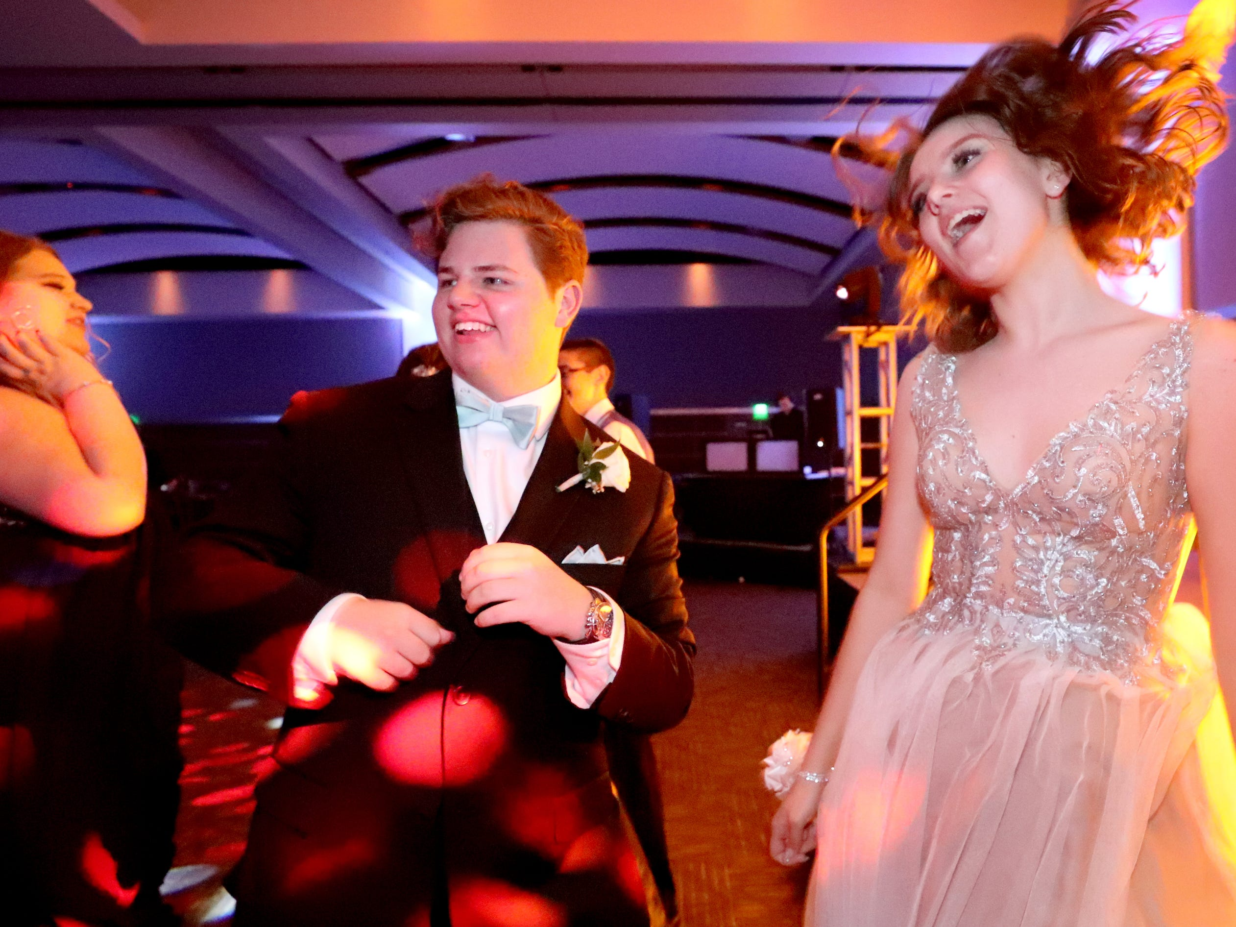 Aaron Music, left and Jessica McKnight, right jump and dance at Blackman's prom on Friday April 12, 2019, at MTSU.