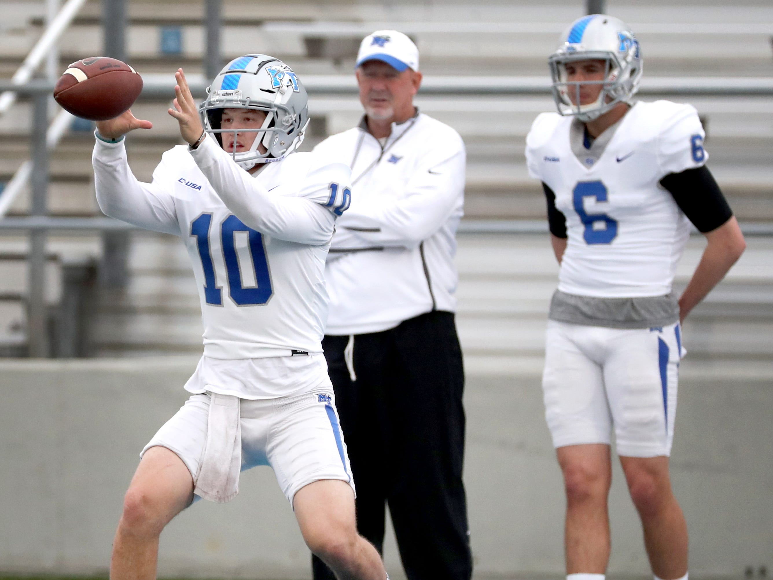 "MTSU's quarterback Asher O'Hara (10) grabs the snap before passing the ball during MTSU's Blue-White Spring Finale held on Saturday April 13, 2019, at MTSU's Johnny ""Red"" Floyd Stadium."