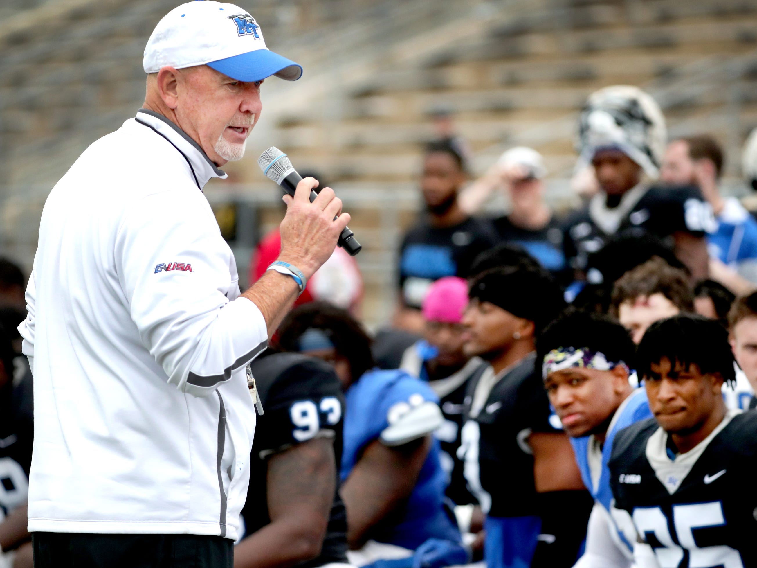 "MTSU's head coach Rick Stockstill talks with the fans and players before the spring awards are handed out during the MTSU's Blue-White Spring Finale held on Saturday April 13, 2019, at MTSU's Johnny ""Red"" Floyd Stadium."
