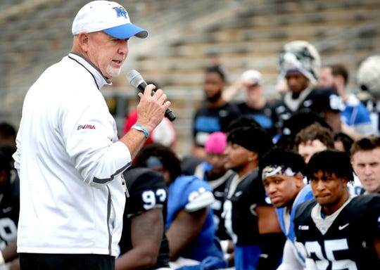 "MTSU head coach Rick Stockstill talks with fans and players during the MTSU's Blue-White Spring Finale on Saturday at Johnny ""Red"" Floyd Stadium."