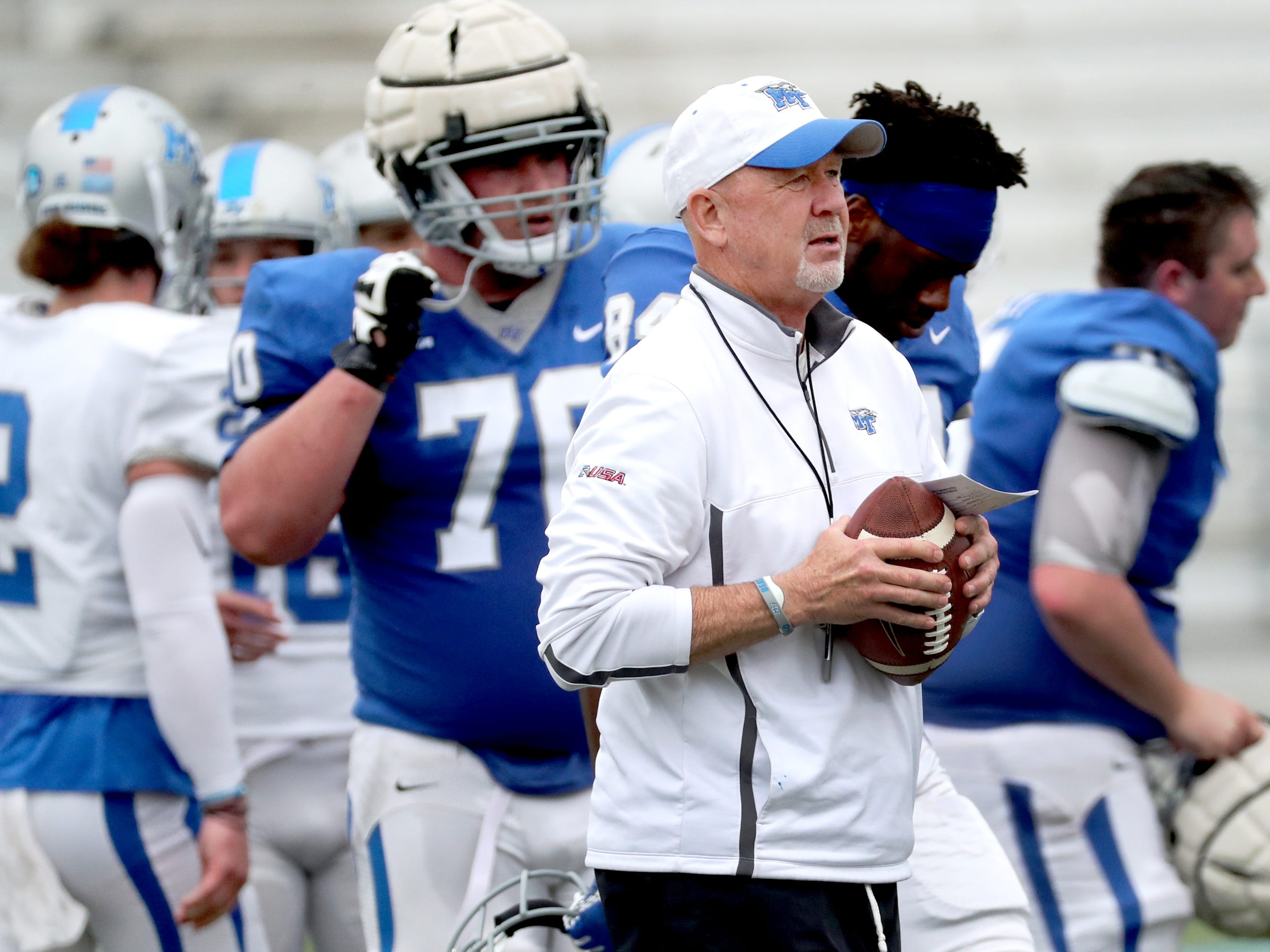 "MTSU's head coach Rick Stockstill gathers players for the awards presentation during MTSU's Blue-White Spring Finale which held on Saturday April 13, 2019, at MTSU's Johnny ""Red"" Floyd Stadium."