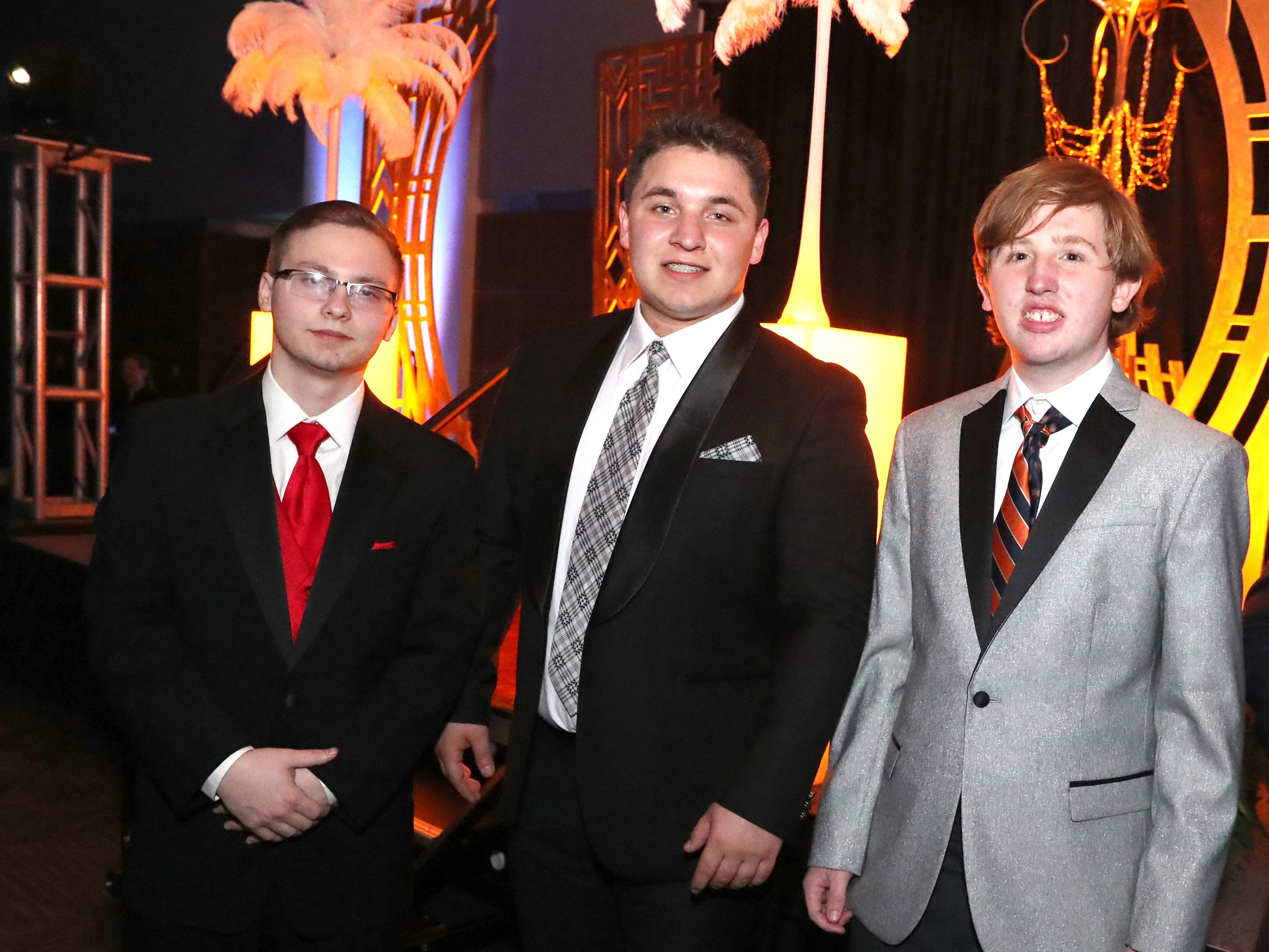 Eric Taylor, left, Alejandro Paez, center and Benjamin Barnes, right at Blackman's prom held on Friday April 12, 2019, at MTSU.