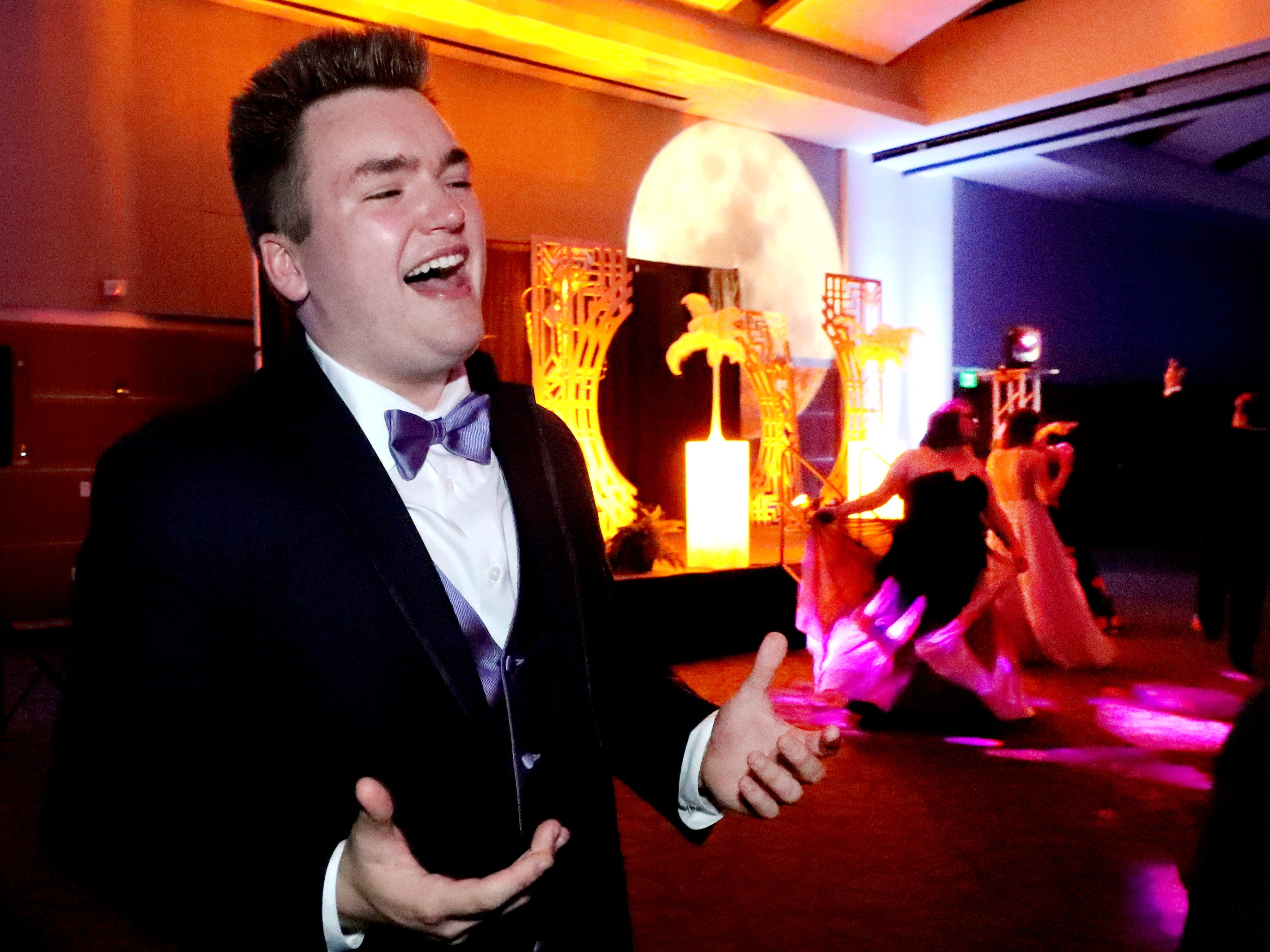 Caleb Strickland sings and dances to a Journey song at Blackman's prom on Friday April 12, 2019, at MTSU.