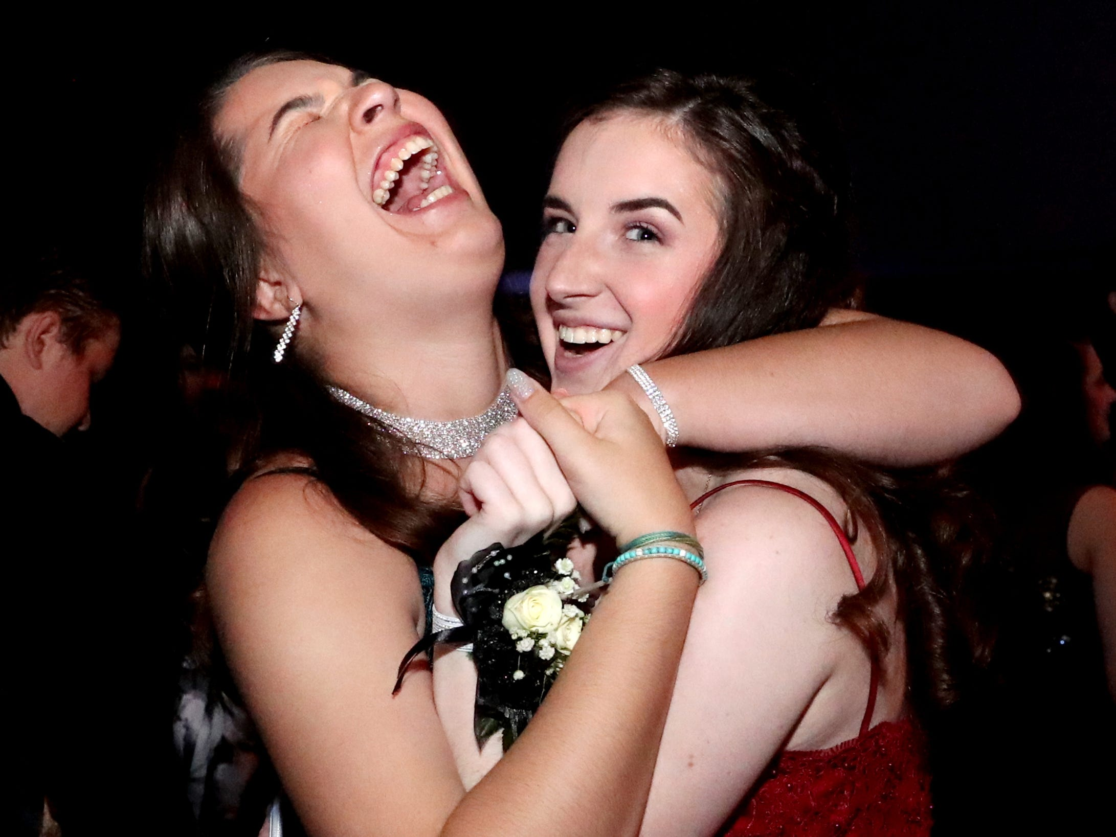 Anna Mincey, left and April Phillips, right have fun at Blackman's prom held on Friday April 12, 2019, at MTSU.