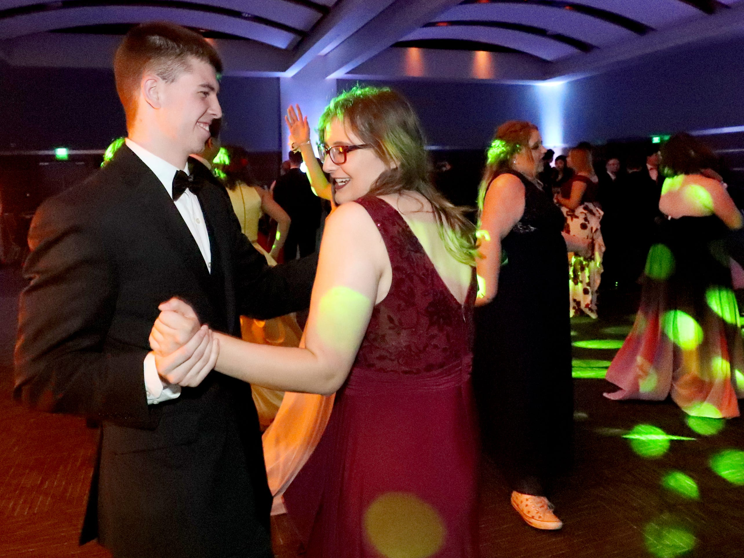 Nathan Bystrom, left and Lian Smith, right dance at Blackman's prom on Friday April 12, 2019, at MTSU.