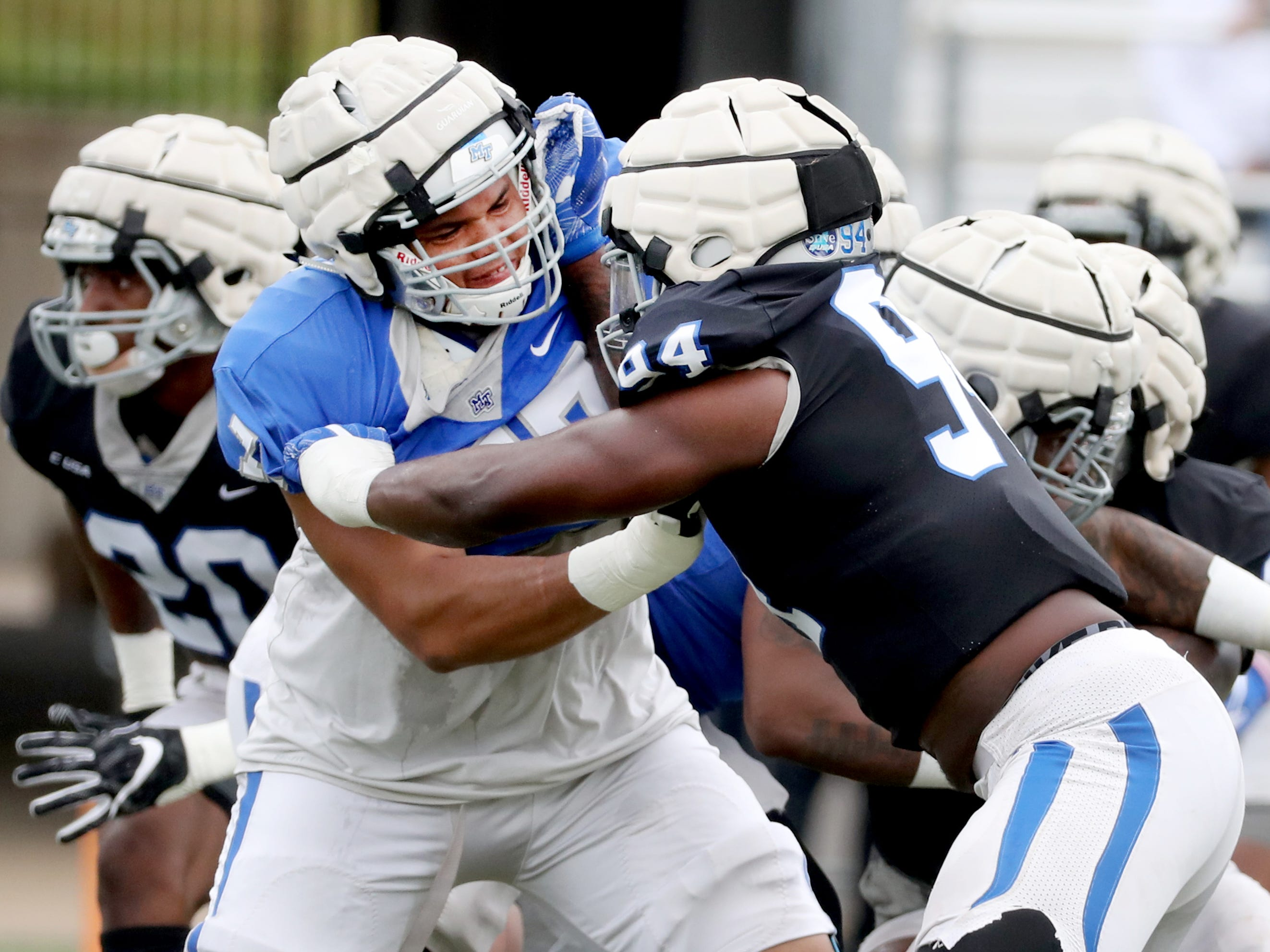 "MTSU's offensive lineman Amir Luckett (77) and MTSU's defensive end Tyshun Render (94) pair off during a drill at MTSU's Blue-White Spring Finale held on Saturday April 13, 2019, at MTSU's Johnny ""Red"" Floyd Stadium."