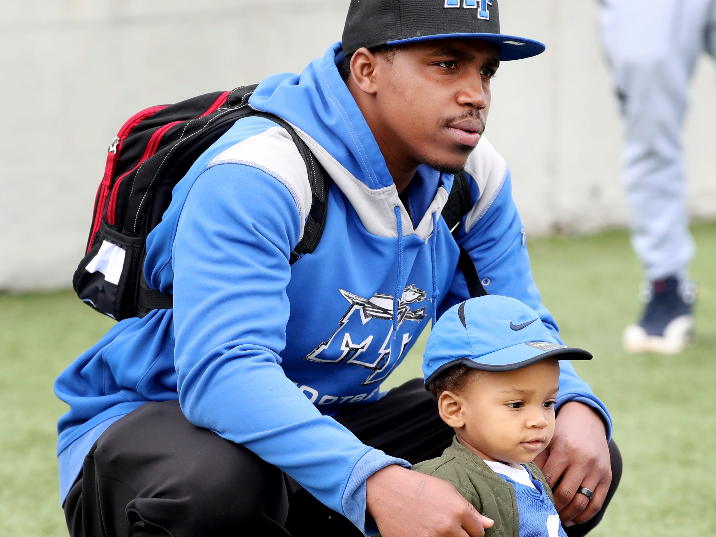 "Former MTSU football player Jeremy Kellem with his son Jeremy Kellem Jr. on the sidelines during MTSU's Blue-White Spring Finale was held on Saturday April 13, 2019, at MTSU's Johnny ""Red"" Floyd Stadium."