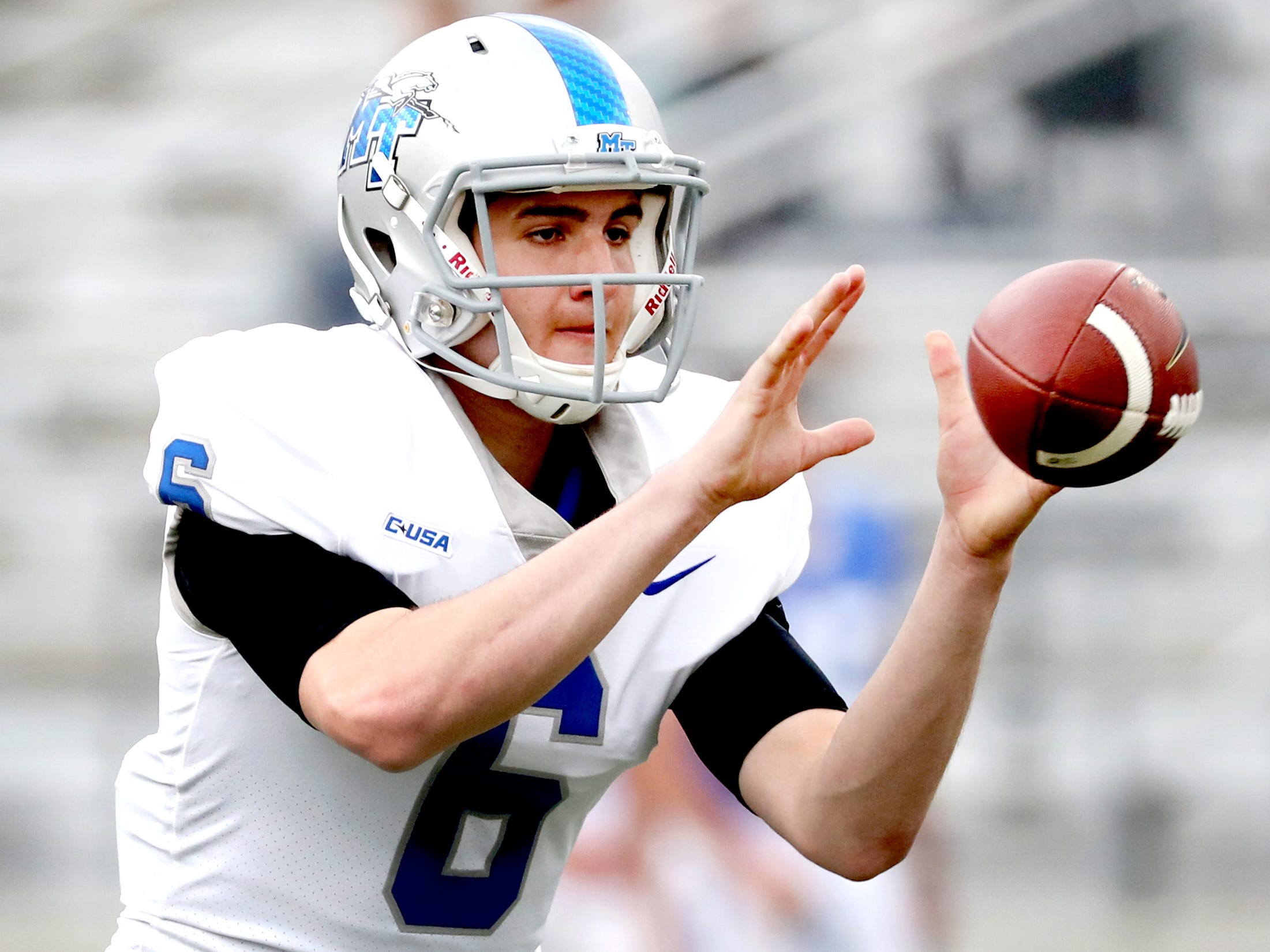 "MTSU's quarterback Chance Nolan (6) grabs the snap before passing the ball during MTSU's Blue-White Spring Finale held on Saturday April 13, 2019, at MTSU's Johnny ""Red"" Floyd Stadium."