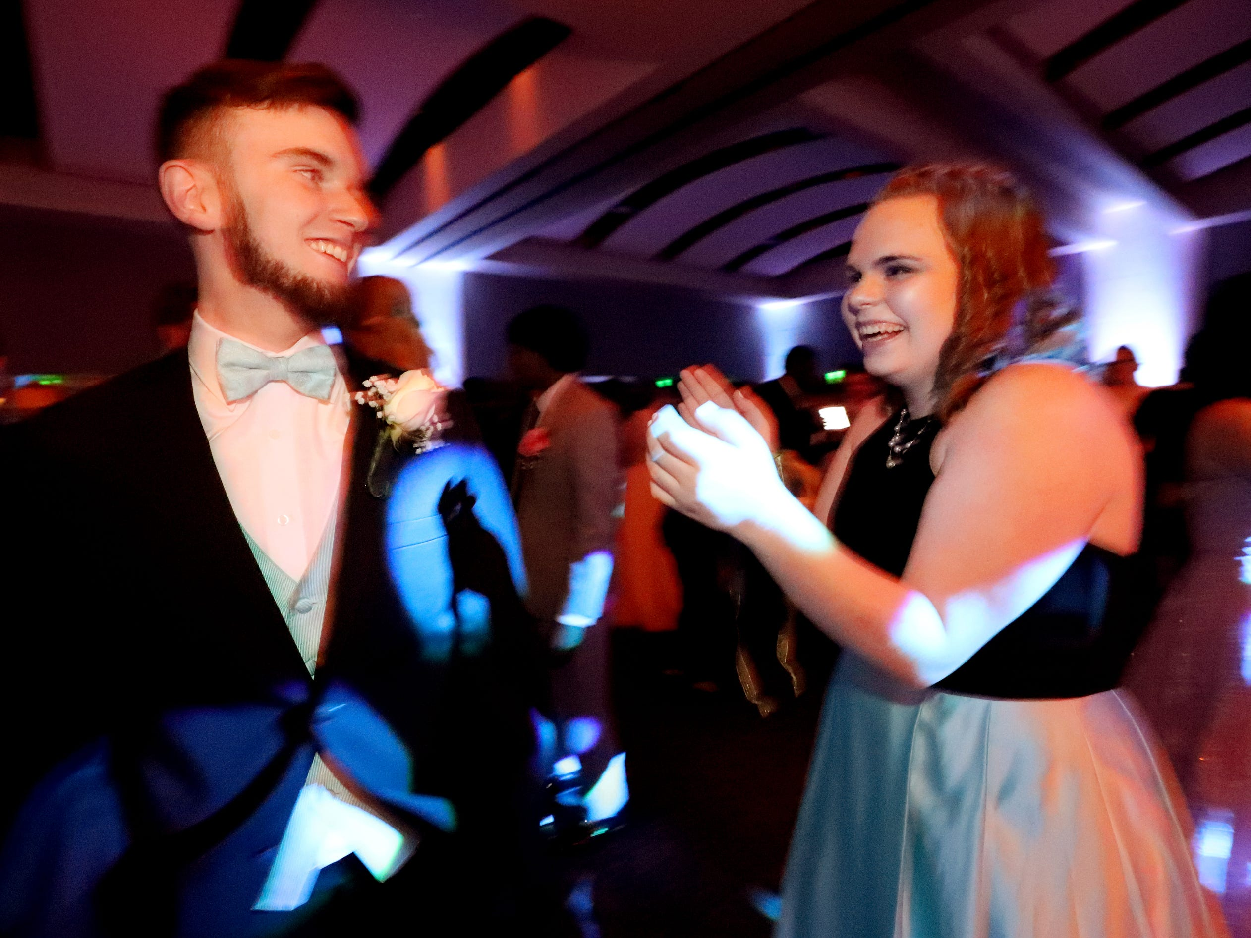 Justin Lane, left and Brianna Kane, right dance together at Blackman's prom on Friday April 12, 2019, at MTSU.