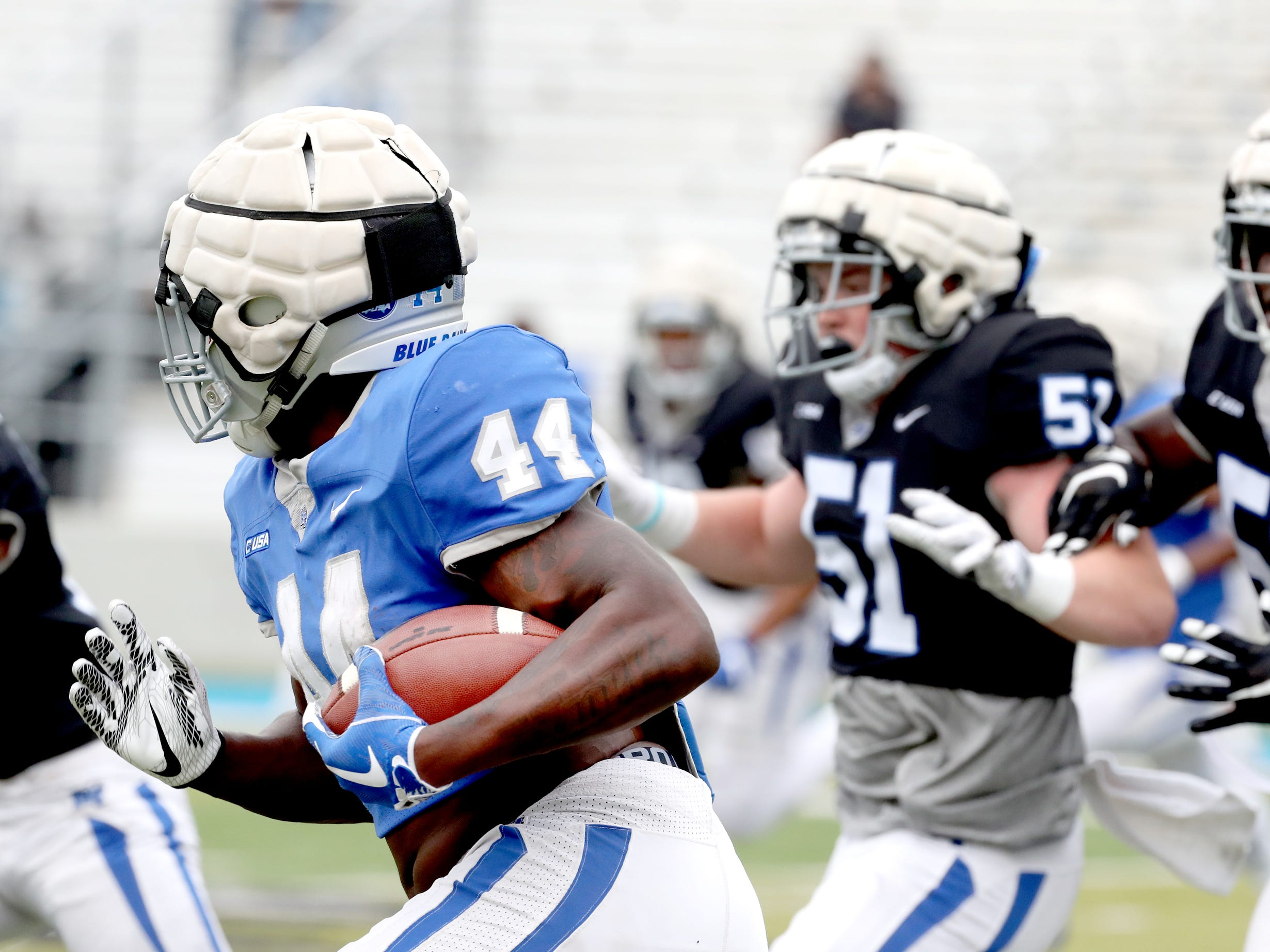 "MTSU's running back Chaton Mobley (44)  runs with the ball during MTSU's Blue-White Spring Finale was held on Saturday April 13, 2019, at MTSU's Johnny ""Red"" Floyd Stadium."