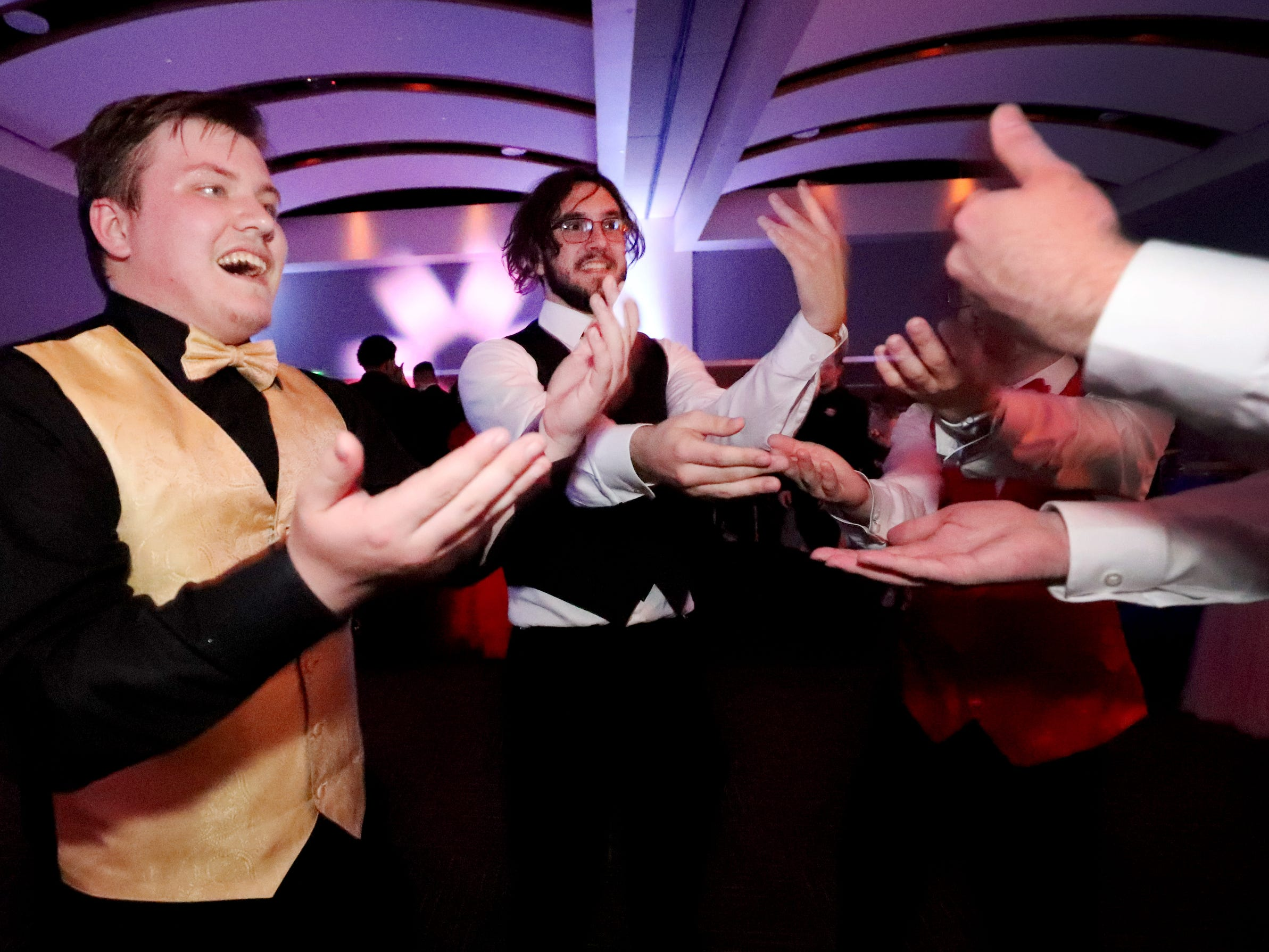 (Left to Right ) Joey Goldberger, Zach Wilder, Everett Davis and Zane Jones joke that the song goes on forever as they all dance the Macarena at Blackman's prom on Friday April 12, 2019, at MTSU.