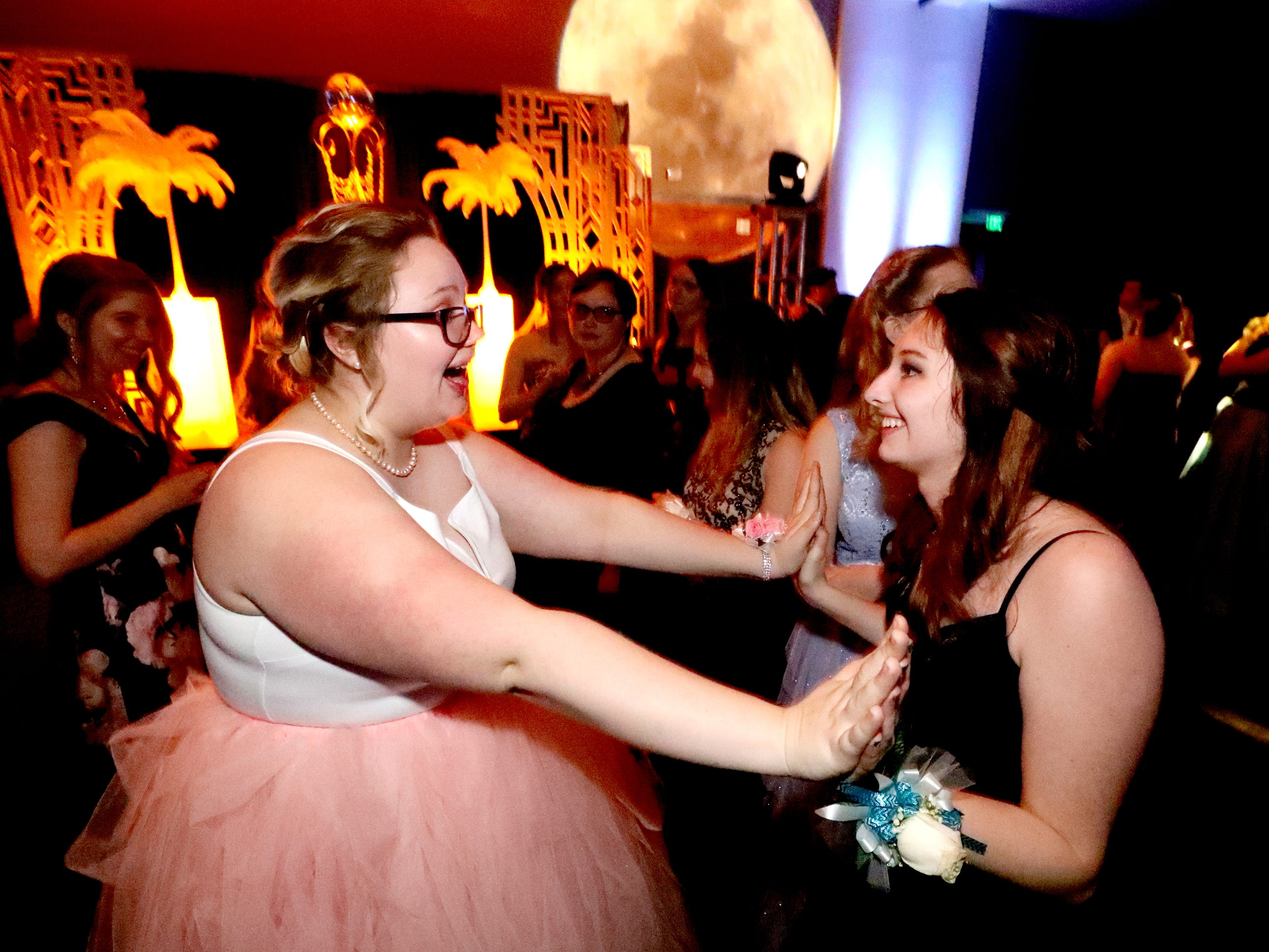 Maggie Cobb, left and Jessica Kearney greet each other at Blackman's prom on Friday April 12, 2019, at MTSU.