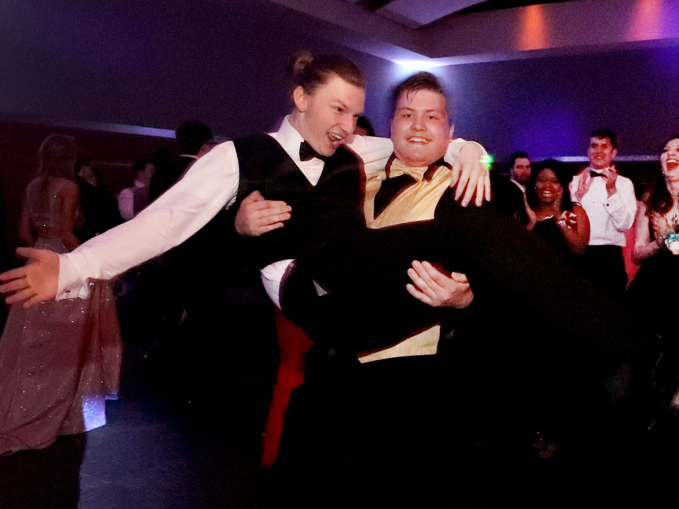 Joey Goldberger lifts Micah Curtis up and spins around with him on the dance floor as others watch at Blackman's prom on Friday April 12, 2019, at MTSU.