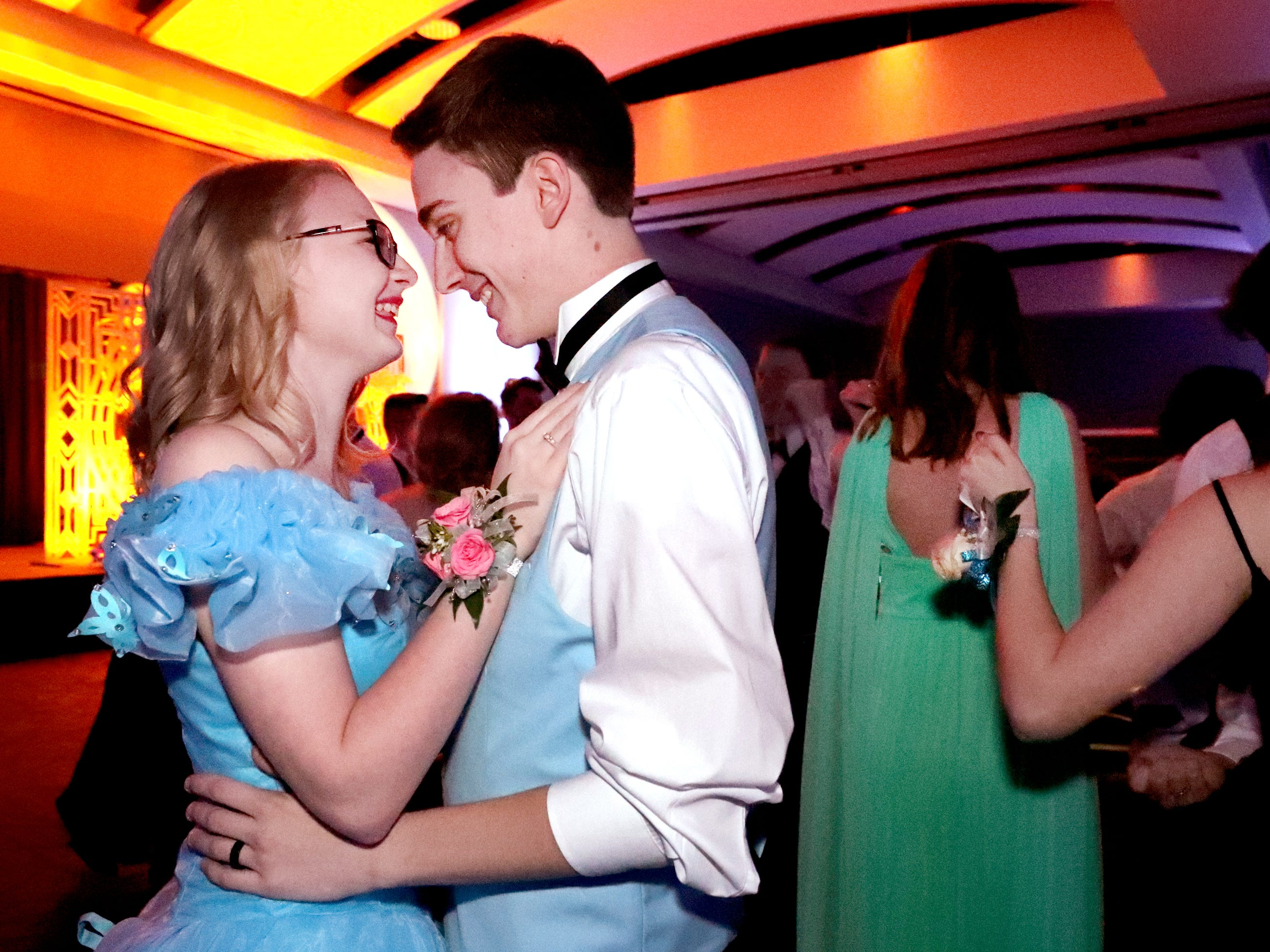 Kaitlin Long, left and Jackson Moore, right dance together at Blackman's prom on Friday April 12, 2019, at MTSU.
