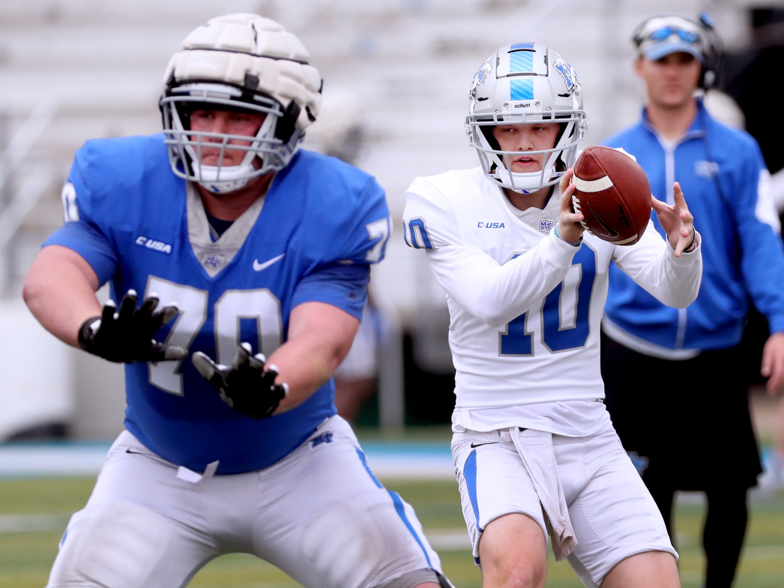 "MTSU's quarterback Asher O'Hara (10) grabs the snap as MTSU's offensive lineman Tyler Falvey (70) blocks for him during MTSU's Blue-White Spring Finale held on Saturday April 13, 2019, at MTSU's Johnny ""Red"" Floyd Stadium."