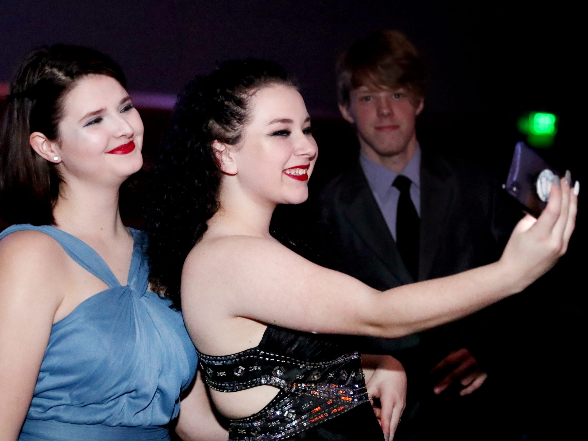 Kaitlyn Dees, left and Olivia Atwell, right take a selfie together at Blackman's prom held on Friday April 12, 2019, at MTSU.