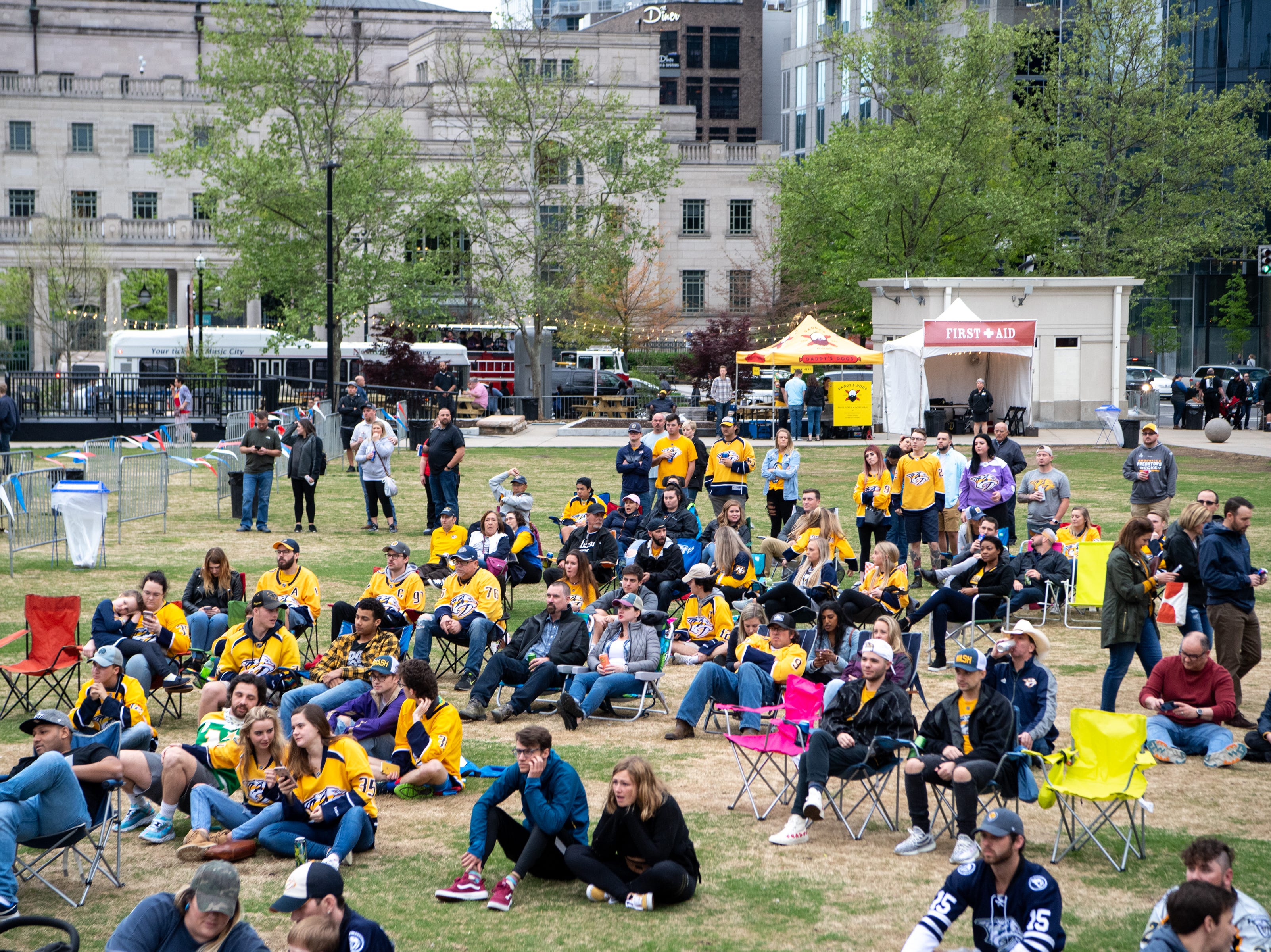 Fans watch the first period of the Nashville Predators game against the Dallas Stars at Preds Party in the Park at Walk of Fame Park Saturday, April 13, 2019, in Nashville, Tenn.