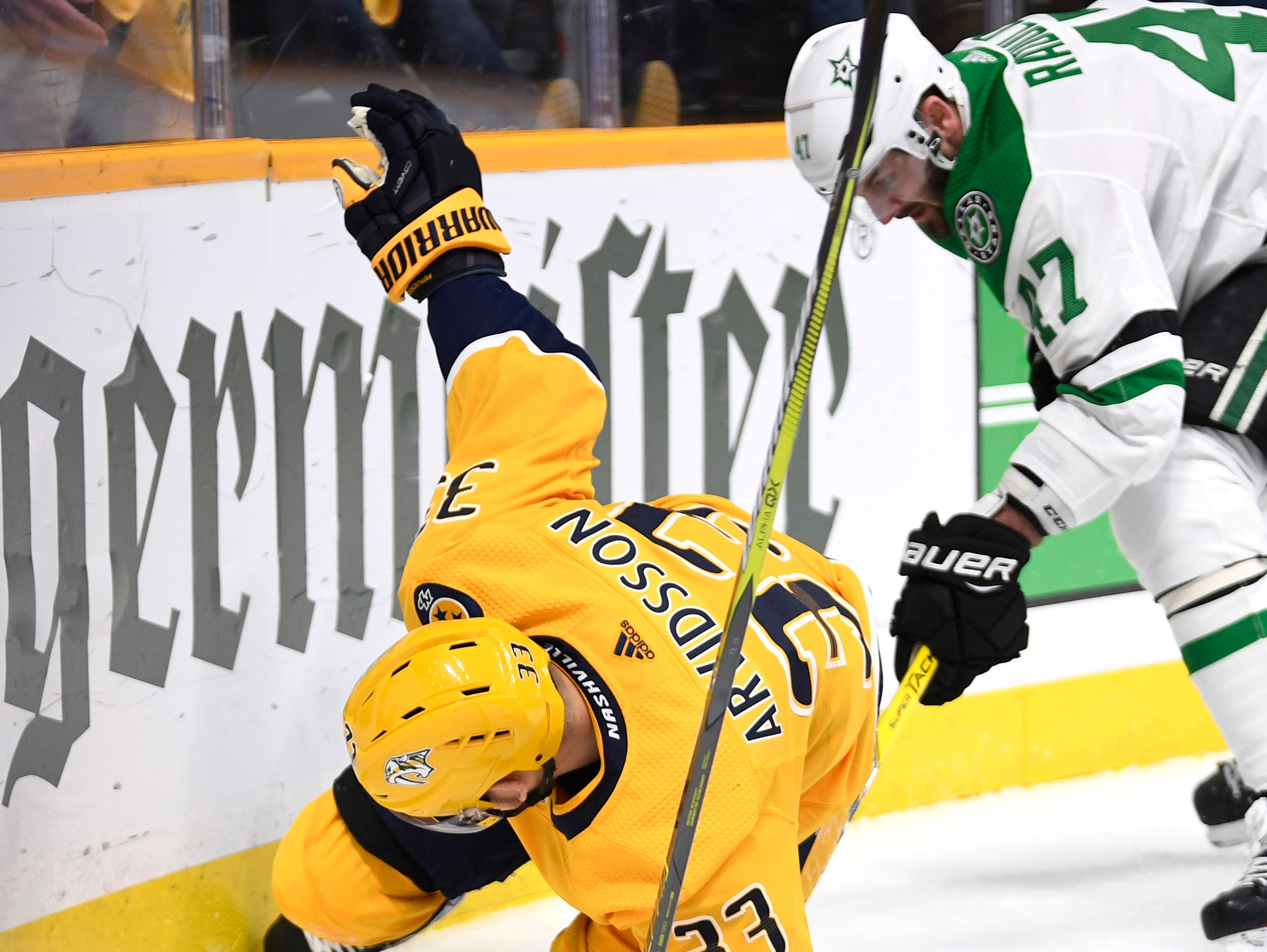 Nashville Predators right wing Viktor Arvidsson (33) battles for the puck with Dallas Stars right wing Alexander Radulov (47) during the first period of the divisional semifinal game at Bridgestone Arena in Nashville, Tenn., Saturday, April 13, 2019.
