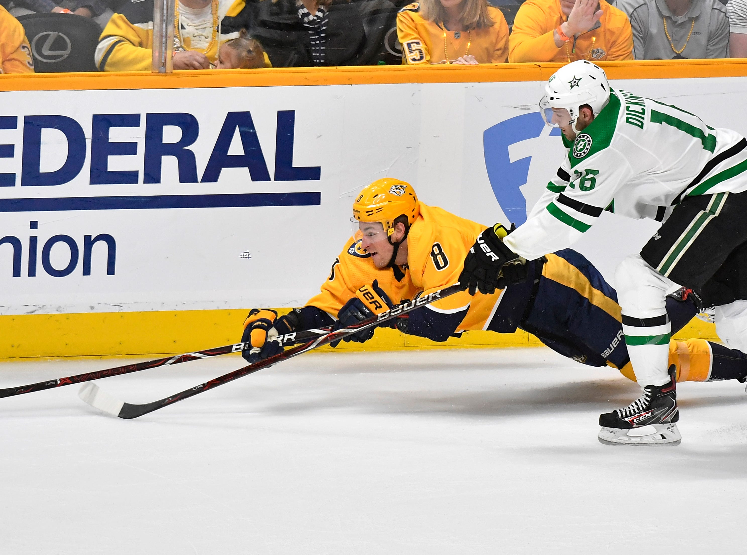 Nashville Predators center Kyle Turris (8) and Dallas Stars center Jason Dickinson (16) battle for the puck during the first period of the divisional semifinal game at Bridgestone Arena in Nashville, Tenn., Saturday, April 13, 2019.