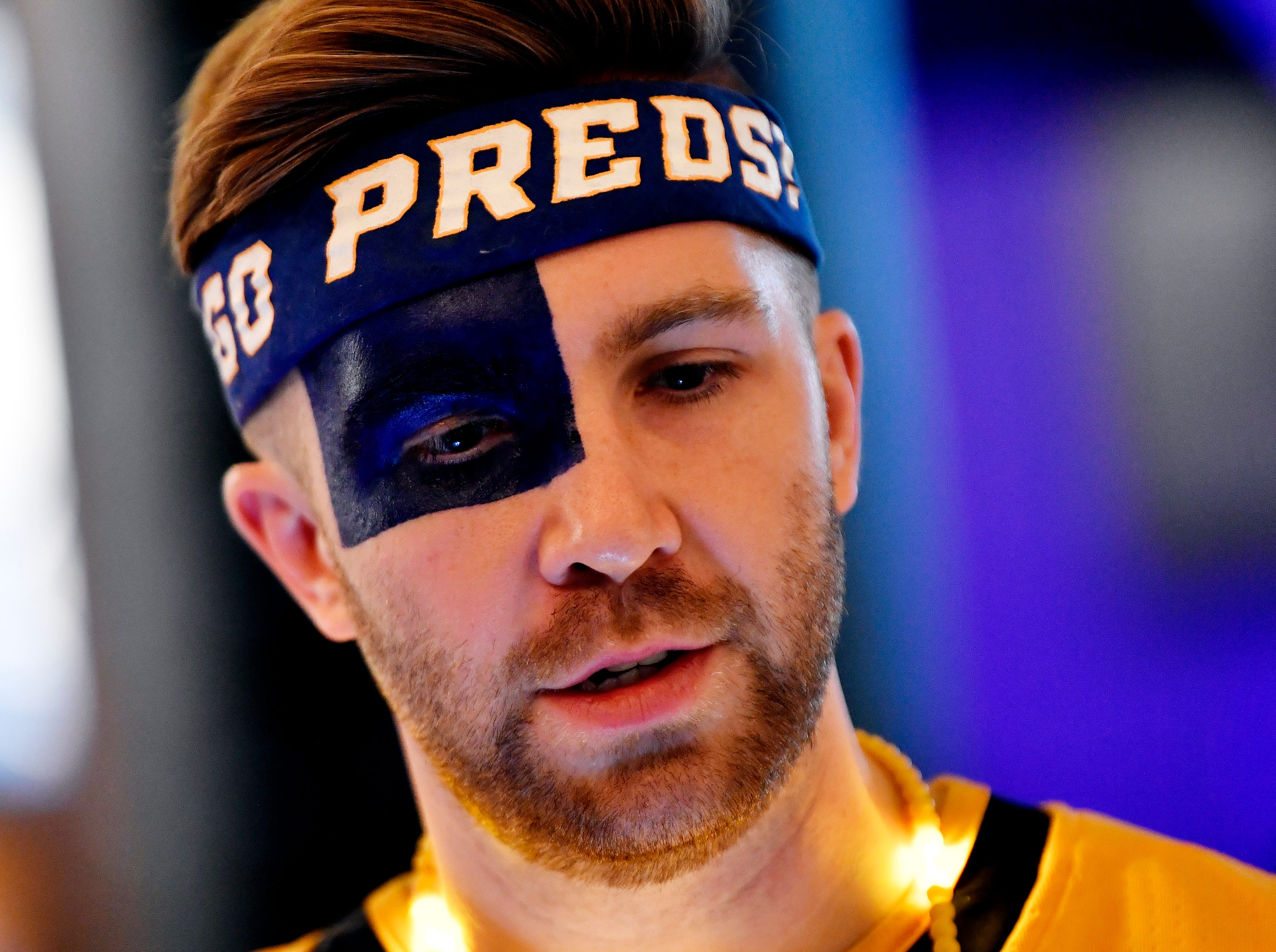 Kyle Miller is decked out in Preds' gear for the divisional semifinal game against Dallas at Bridgestone Arena in Nashville, Tenn., Saturday, April 13, 2019.