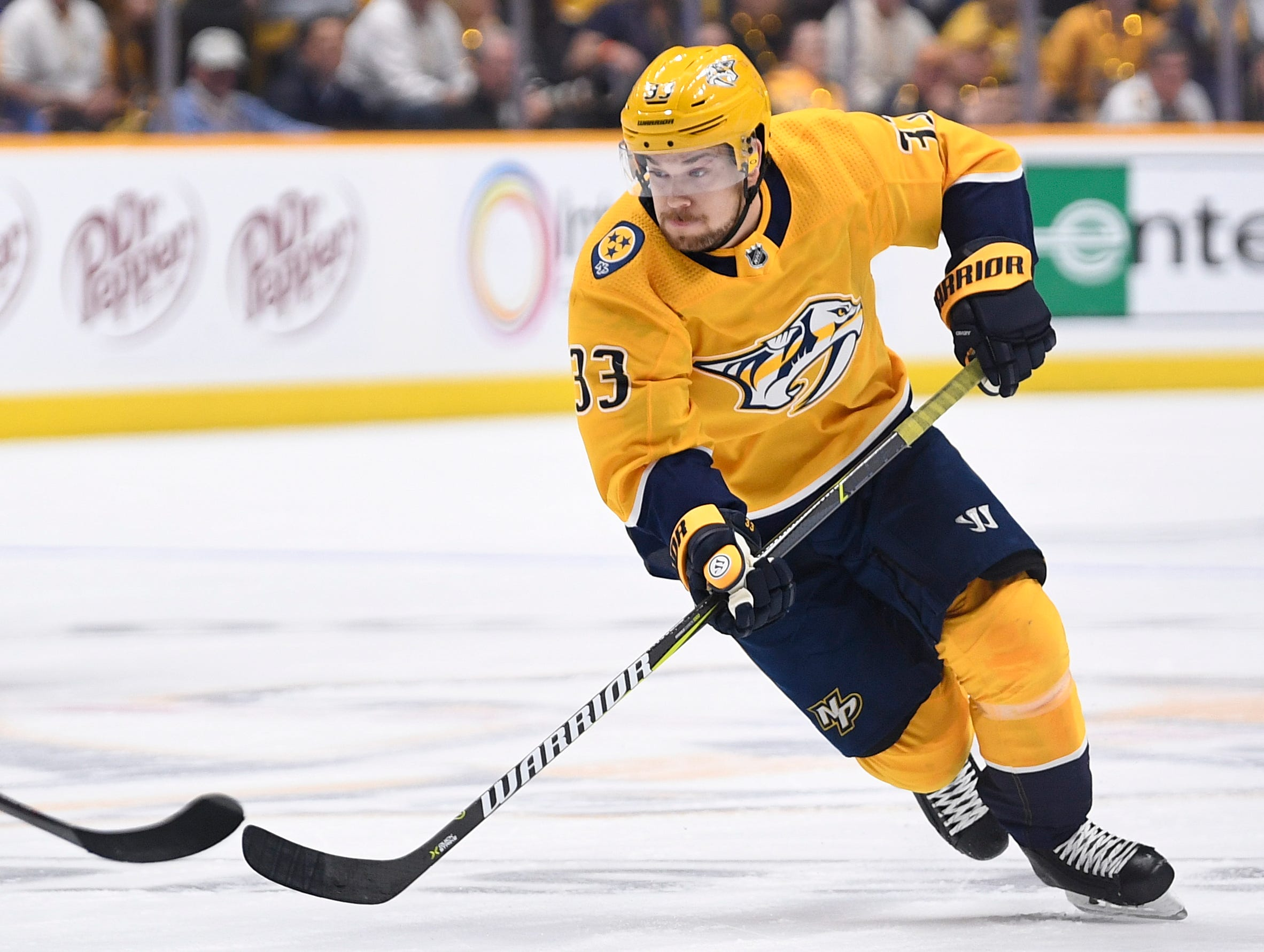 Nashville Predators right wing Viktor Arvidsson (33) moves the puck during the first period of the divisional semifinal game against the Dallas Stars at Bridgestone Arena in Nashville, Tenn., Saturday, April 13, 2019.