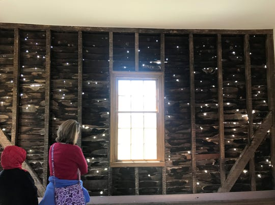 The Carter House's wood-frame farm office outbuilding is riddled with bullet holes, strike marks and ricocheted bullets.