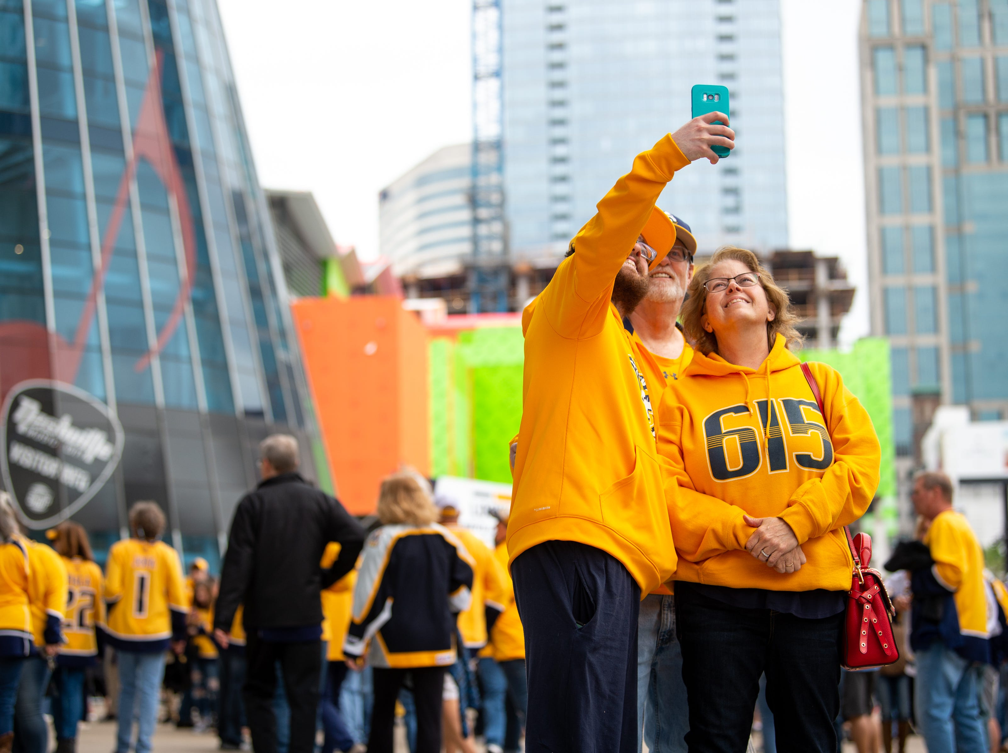 Fans take a selfie before the Nashville Predators game against the Dallas Stars at Bridgestone Arena Saturday, April 13, 2019, in Nashville, Tenn.