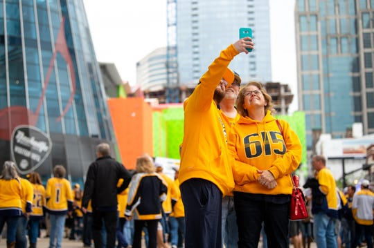 Fans take a selfie before the Nashville Predators game against the Dallas Stars at Bridgestone Arena Saturday, April 13, 2019, in Nashville, Tenn.