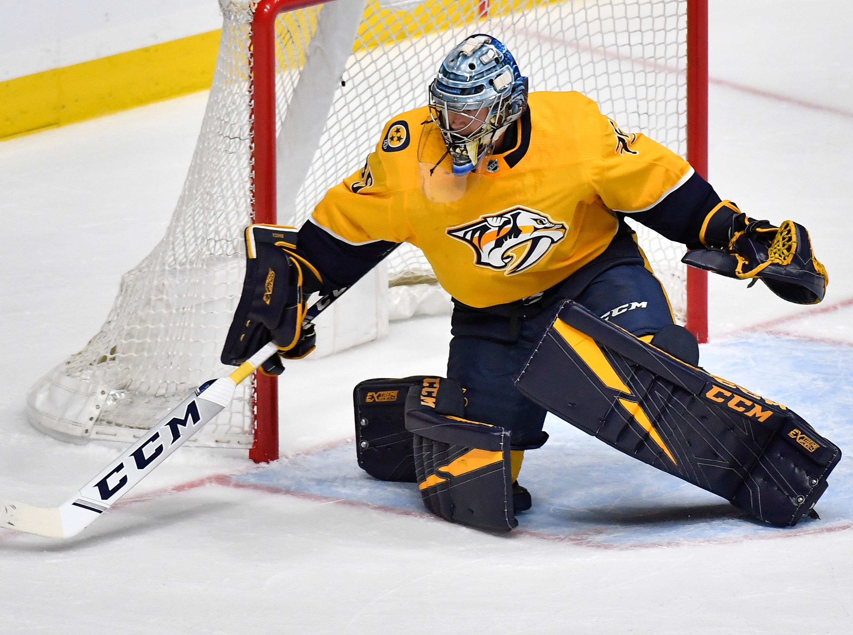 Nashville Predators goaltender Pekka Rinne (35) plays a puck wide during the first period of the divisional semifinal game against the Dallas Stars at Bridgestone Arena in Nashville, Tenn., Saturday, April 13, 2019.